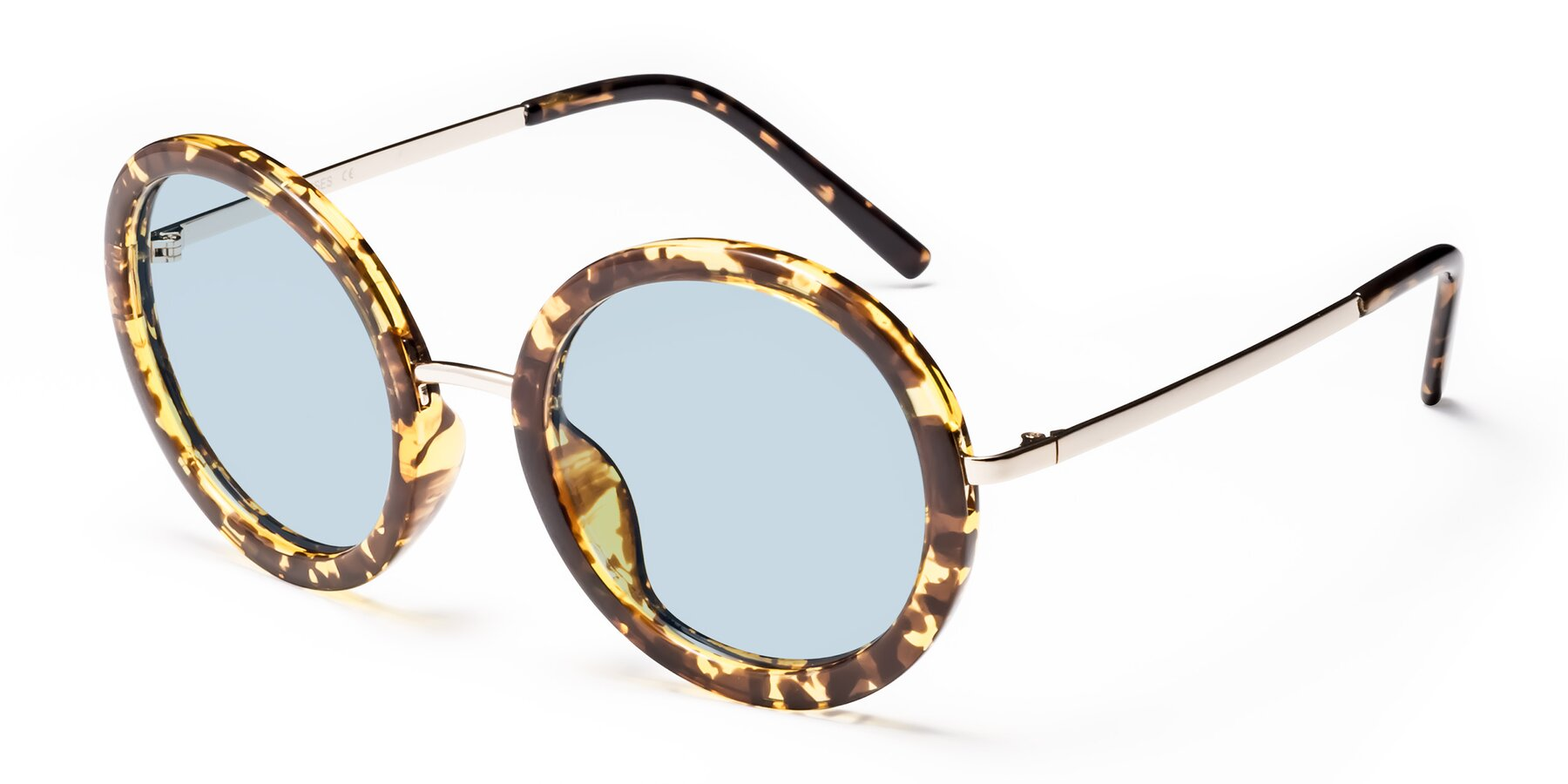 Angle of Bloom in Transparent Tortoise with Light Blue Tinted Lenses