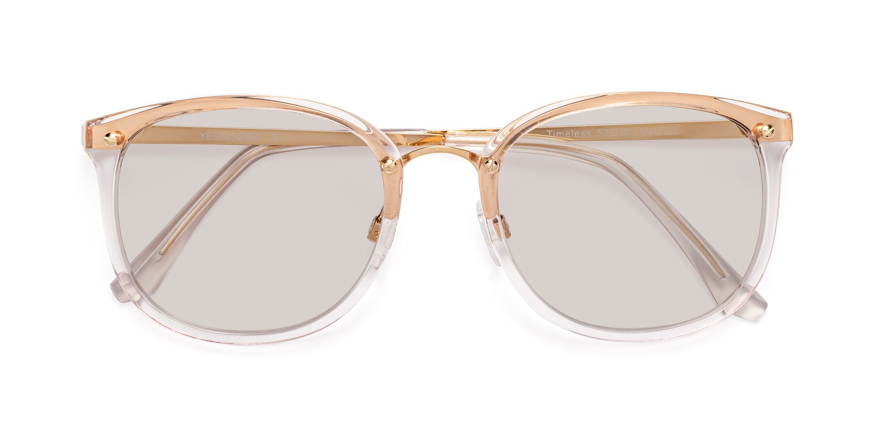 Folded Front of Timeless in Transparent Pink with Light Brown Tinted Lenses