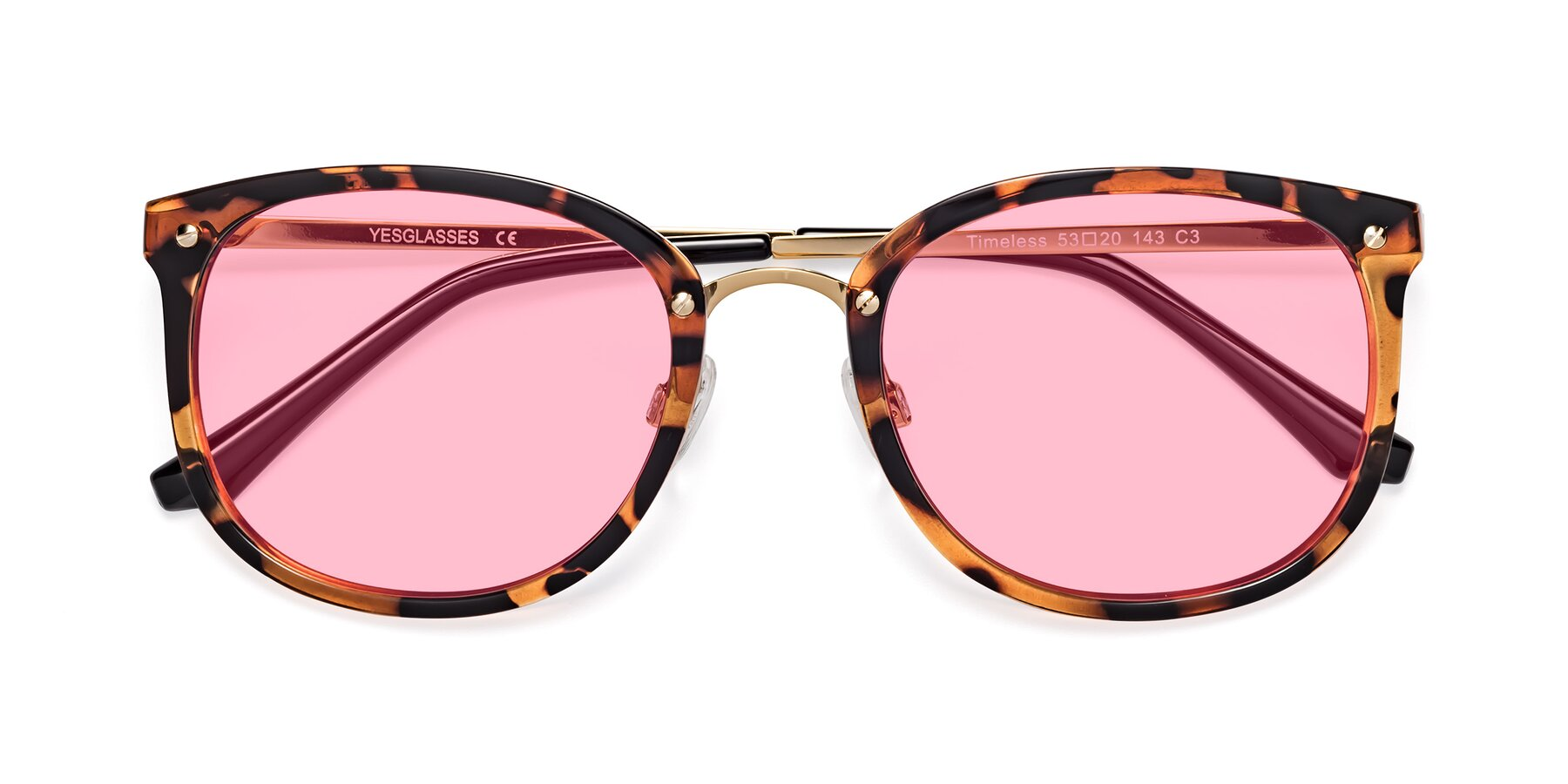 Folded Front of Timeless in Tortoise-Golden with Medium Pink Tinted Lenses