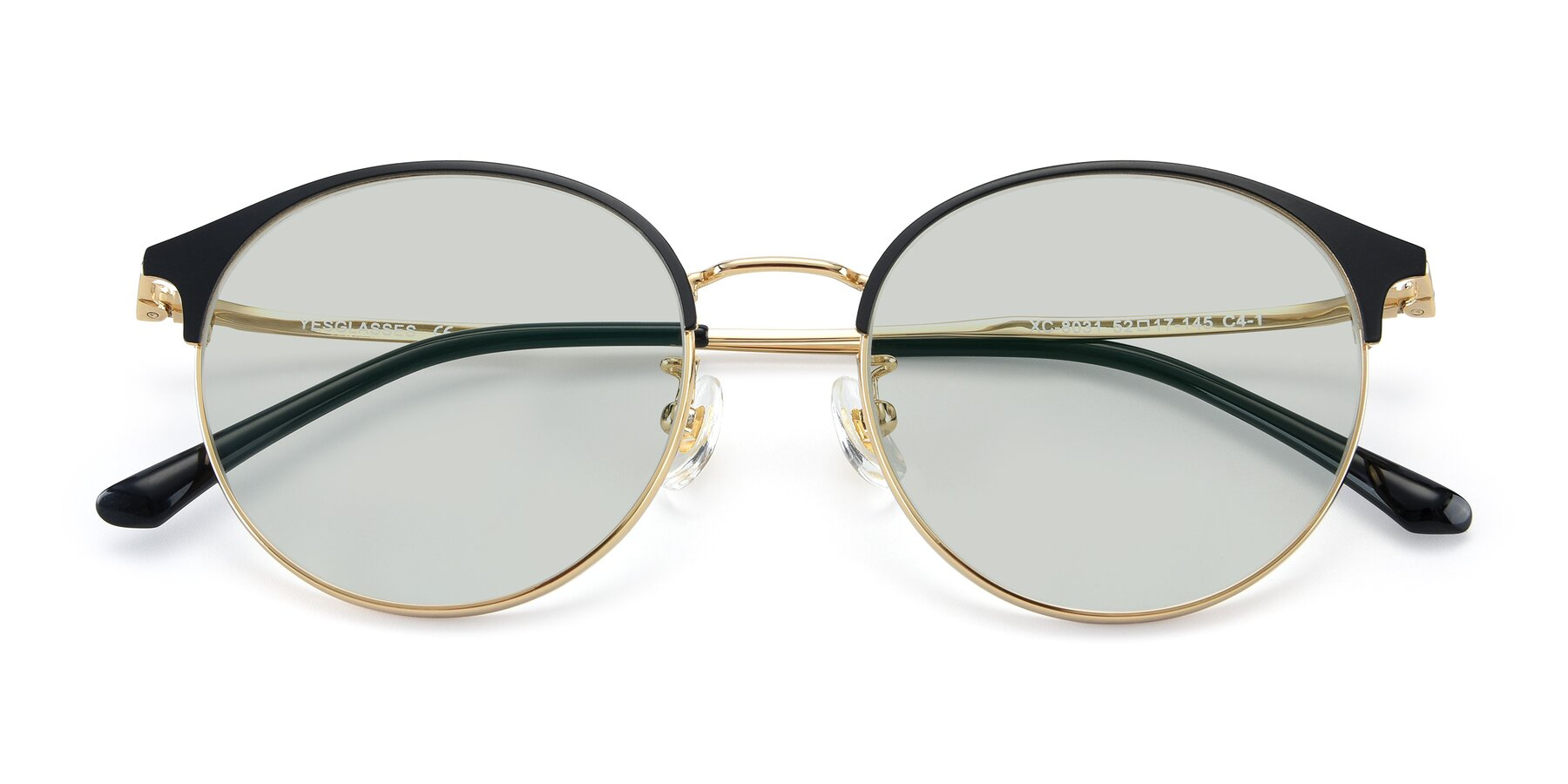 Folded Front of XC-8031 in Black-Gold with Light Green Tinted Lenses
