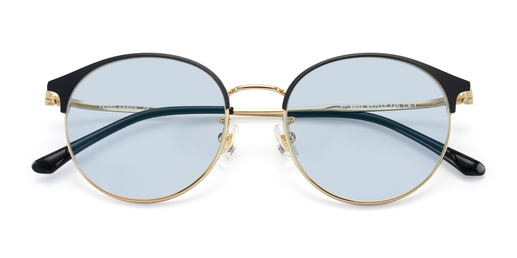 Folded Front of XC-8031 in Black-Gold with Light Blue Tinted Lenses