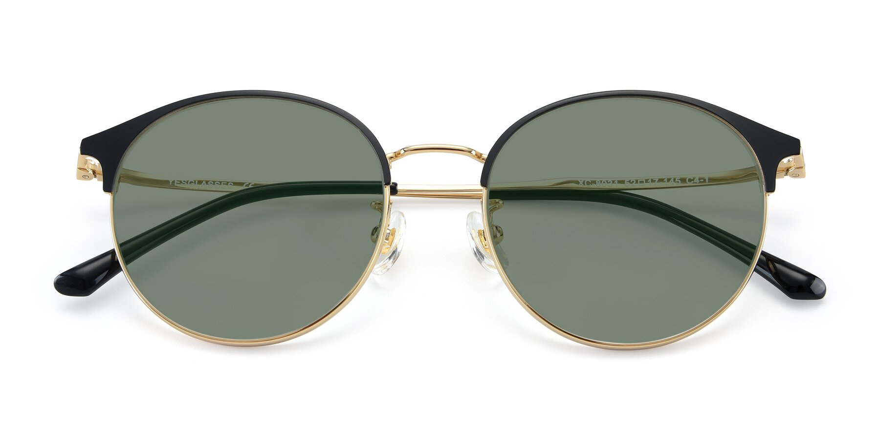 Folded Front of XC-8031 in Black-Gold with Medium Green Tinted Lenses