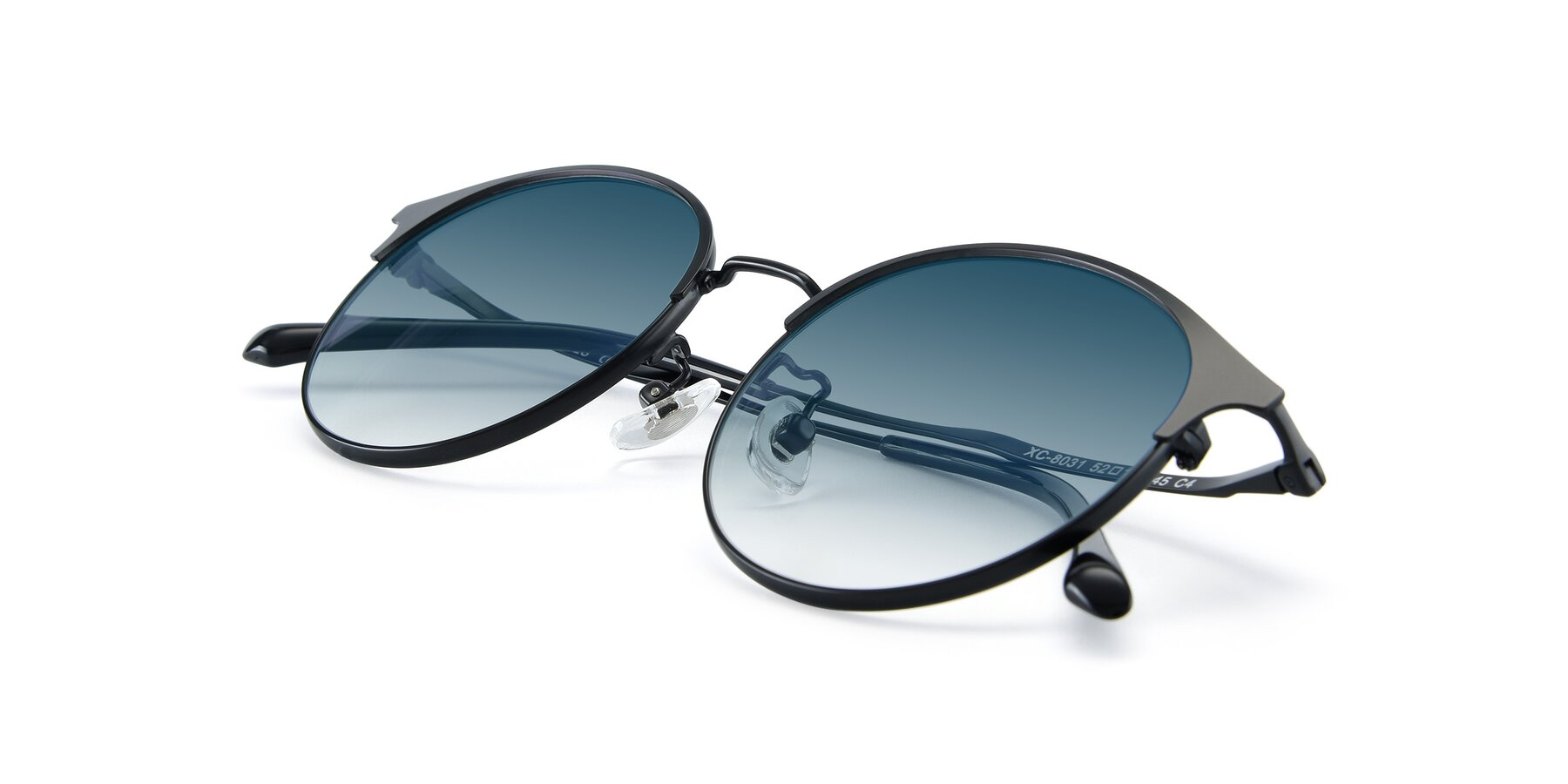 View of XC-8031 in Matte Black with Blue Gradient Lenses