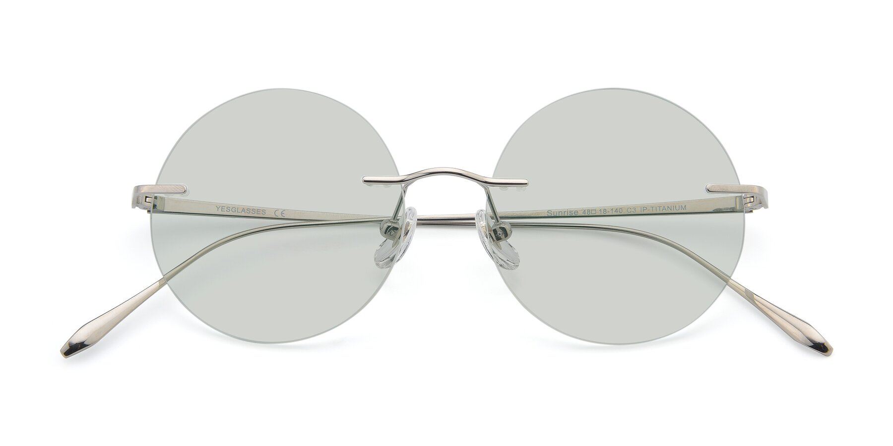 Folded Front of Sunrise in Silver with Light Green Tinted Lenses