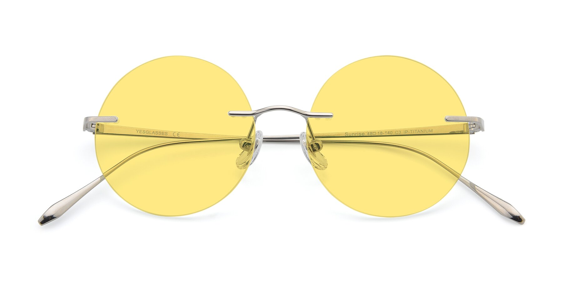 Folded Front of Sunrise in Silver with Medium Yellow Tinted Lenses