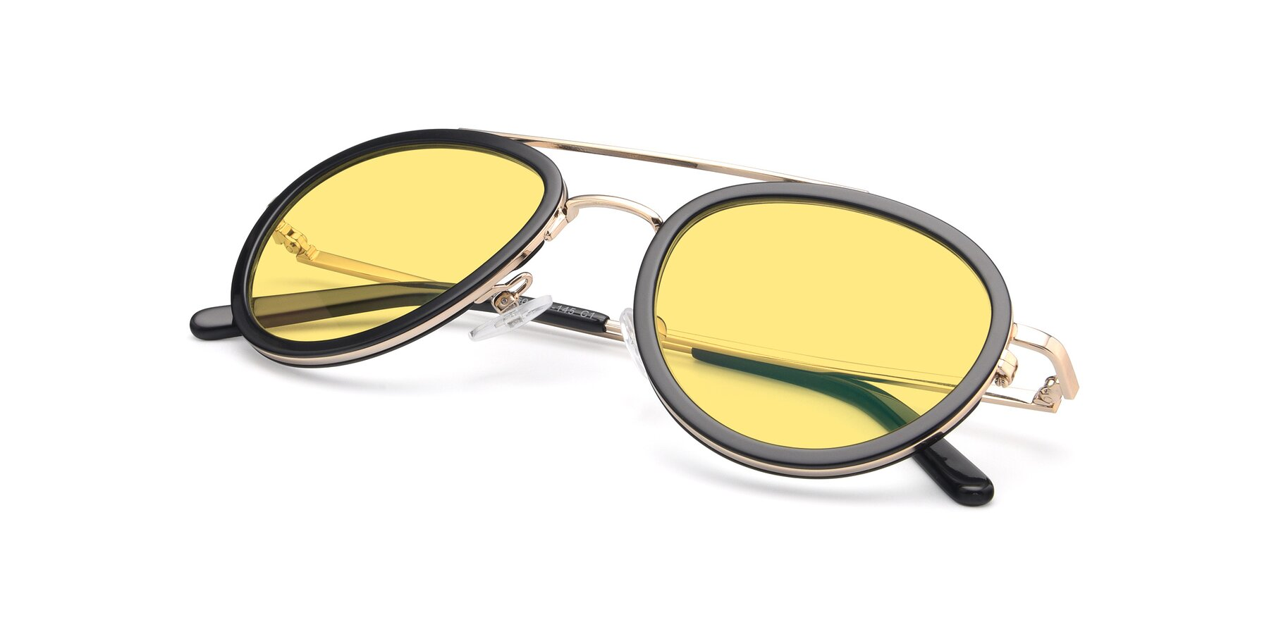 View of 9554 in Black-Gold with Medium Yellow Tinted Lenses