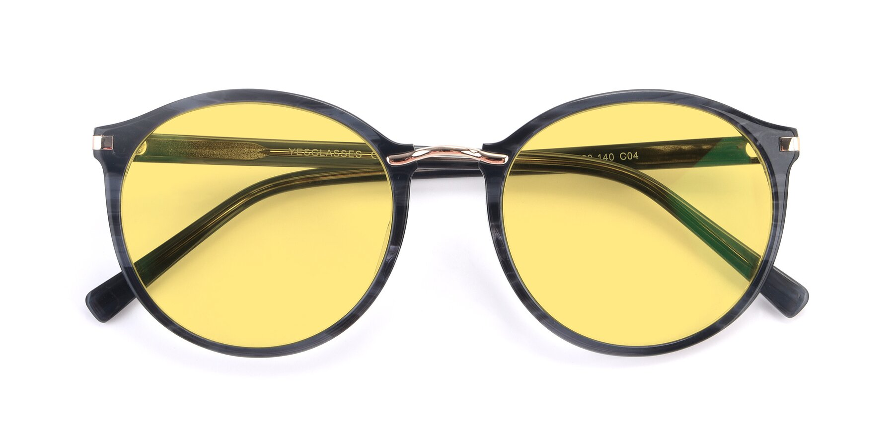 Folded Front of Casper in Translucent Black with Medium Yellow Tinted Lenses