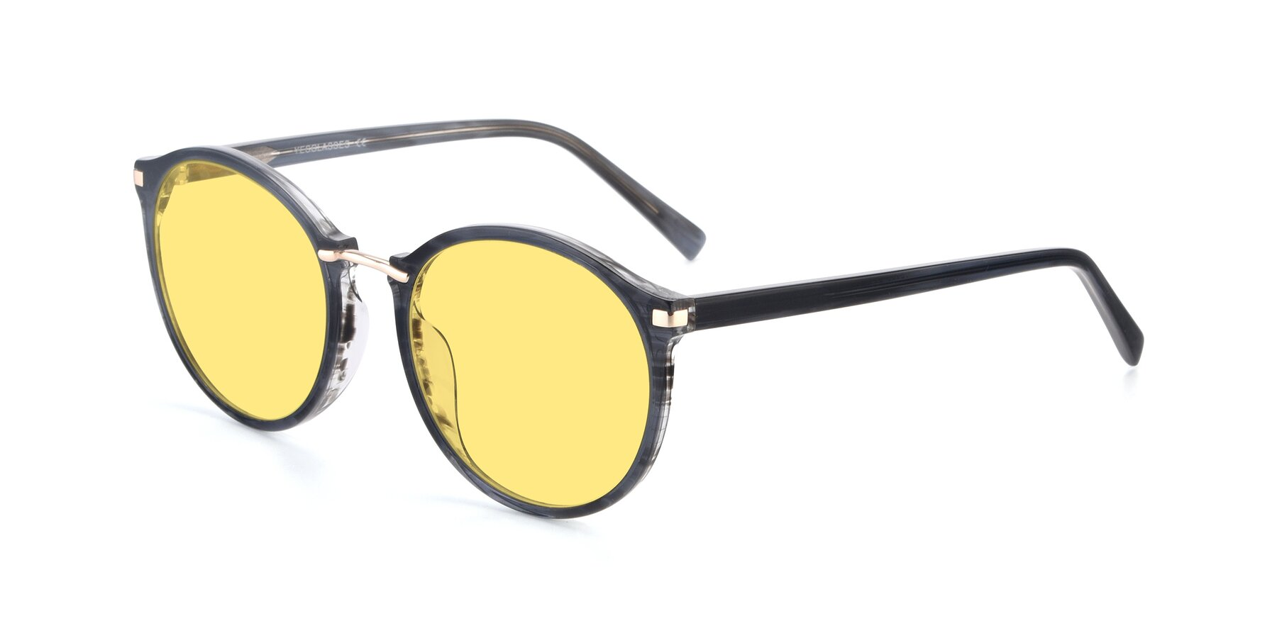 Angle of Casper in Translucent Black with Medium Yellow Tinted Lenses