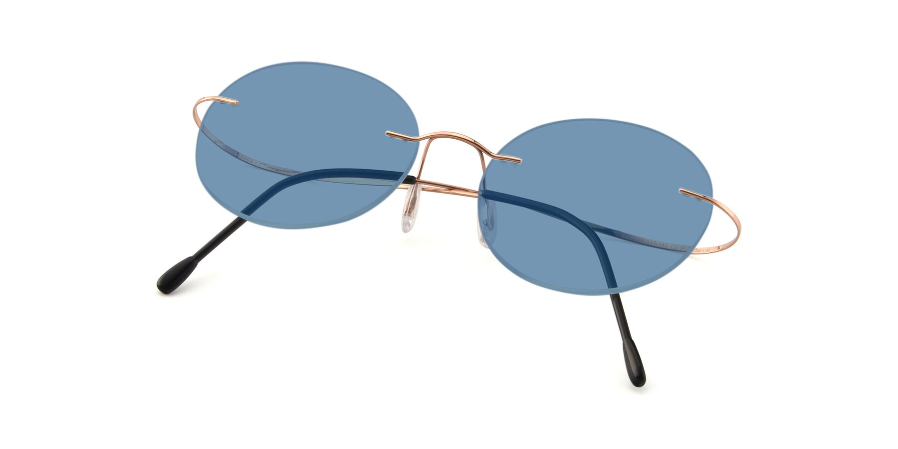 View of Leon in Rose Gold with Medium Blue Tinted Lenses