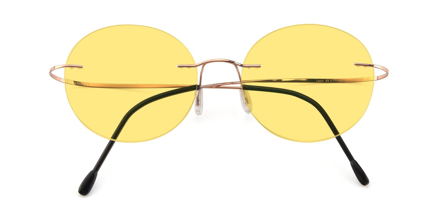Folded Front of Leon in Rose Gold with Medium Yellow Tinted Lenses