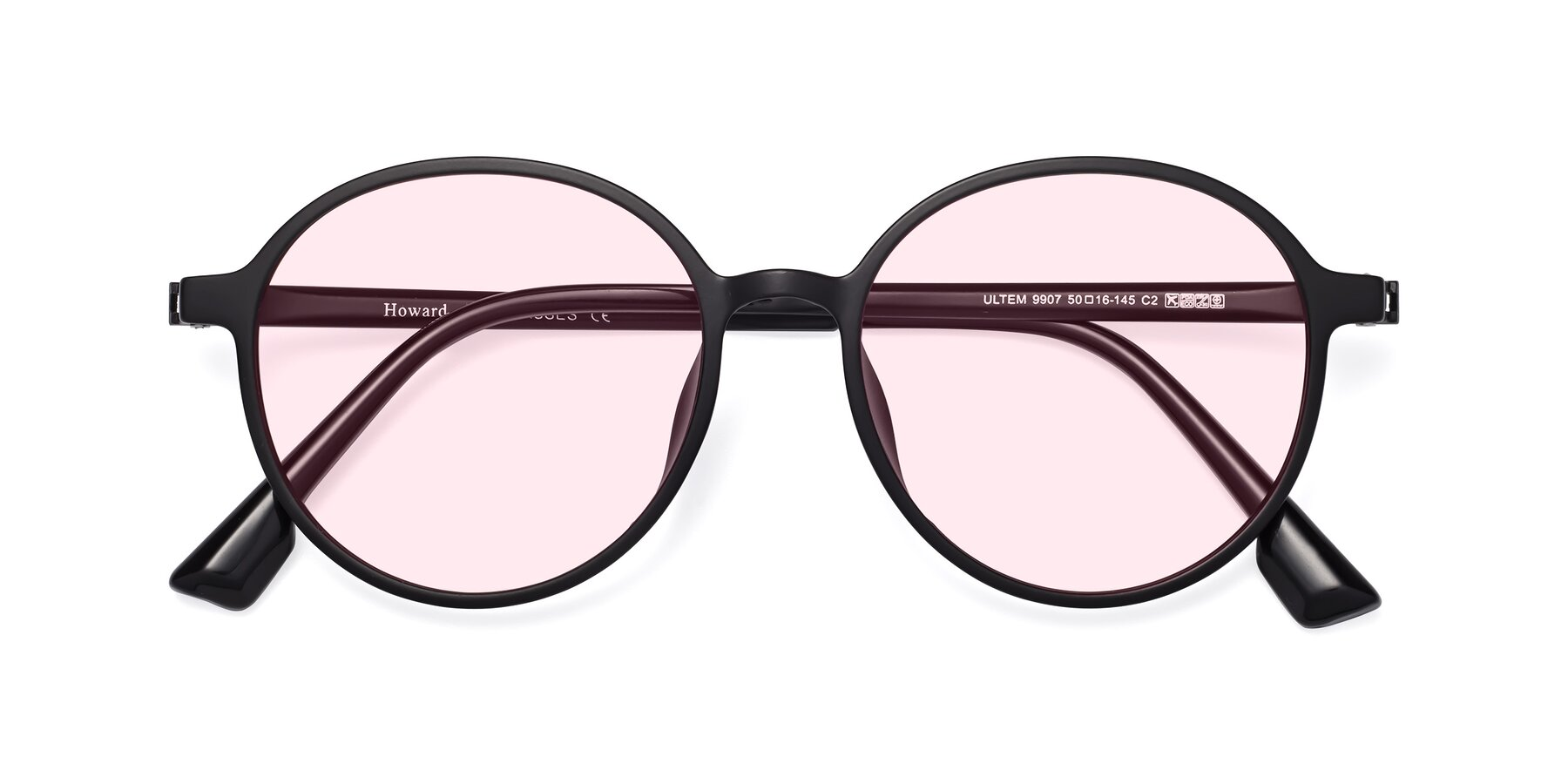 Folded Front of Howard in Matte Black with Light Pink Tinted Lenses