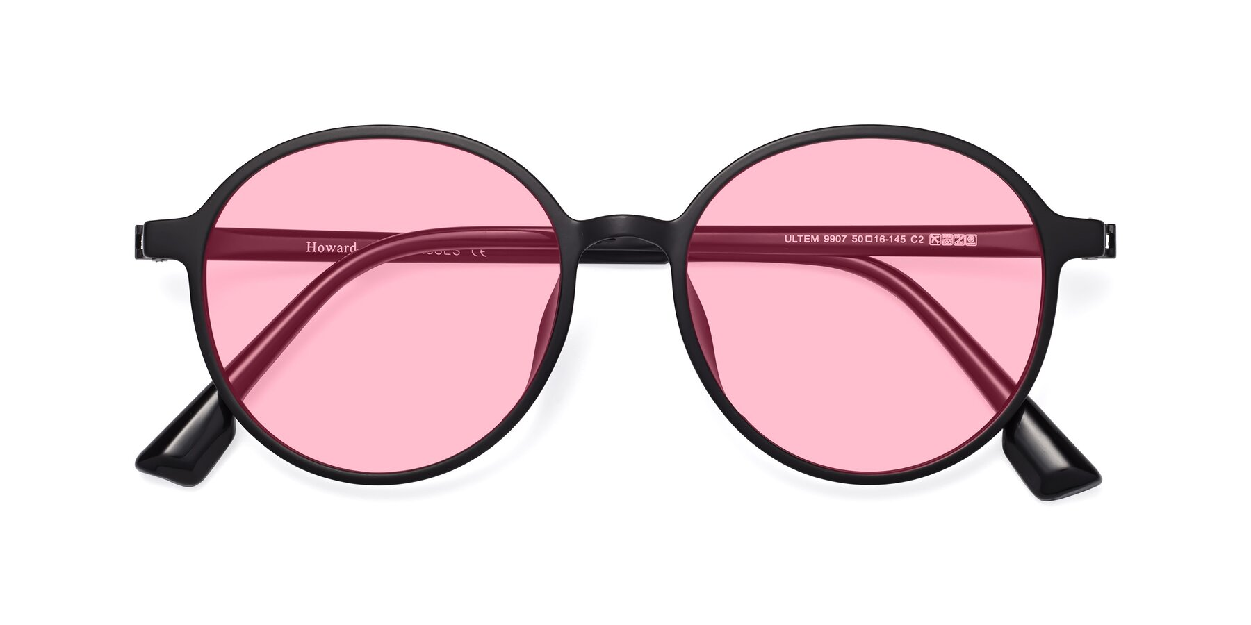 Folded Front of Howard in Matte Black with Medium Pink Tinted Lenses