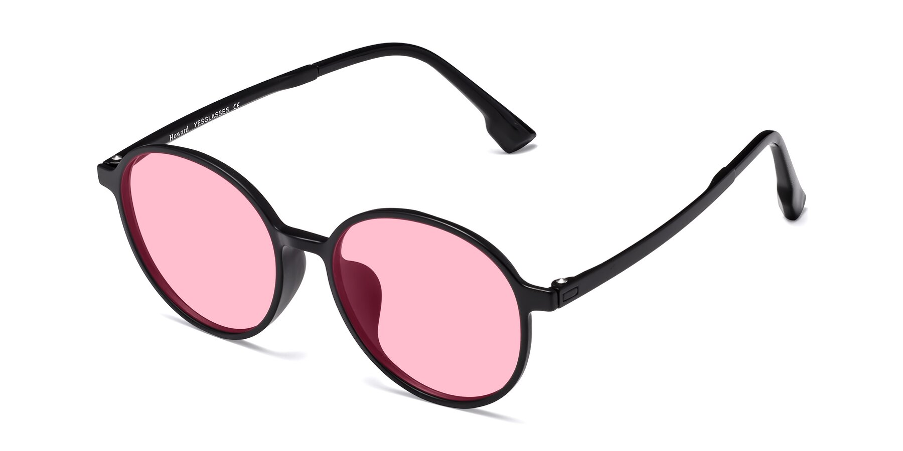 Angle of Howard in Matte Black with Medium Pink Tinted Lenses