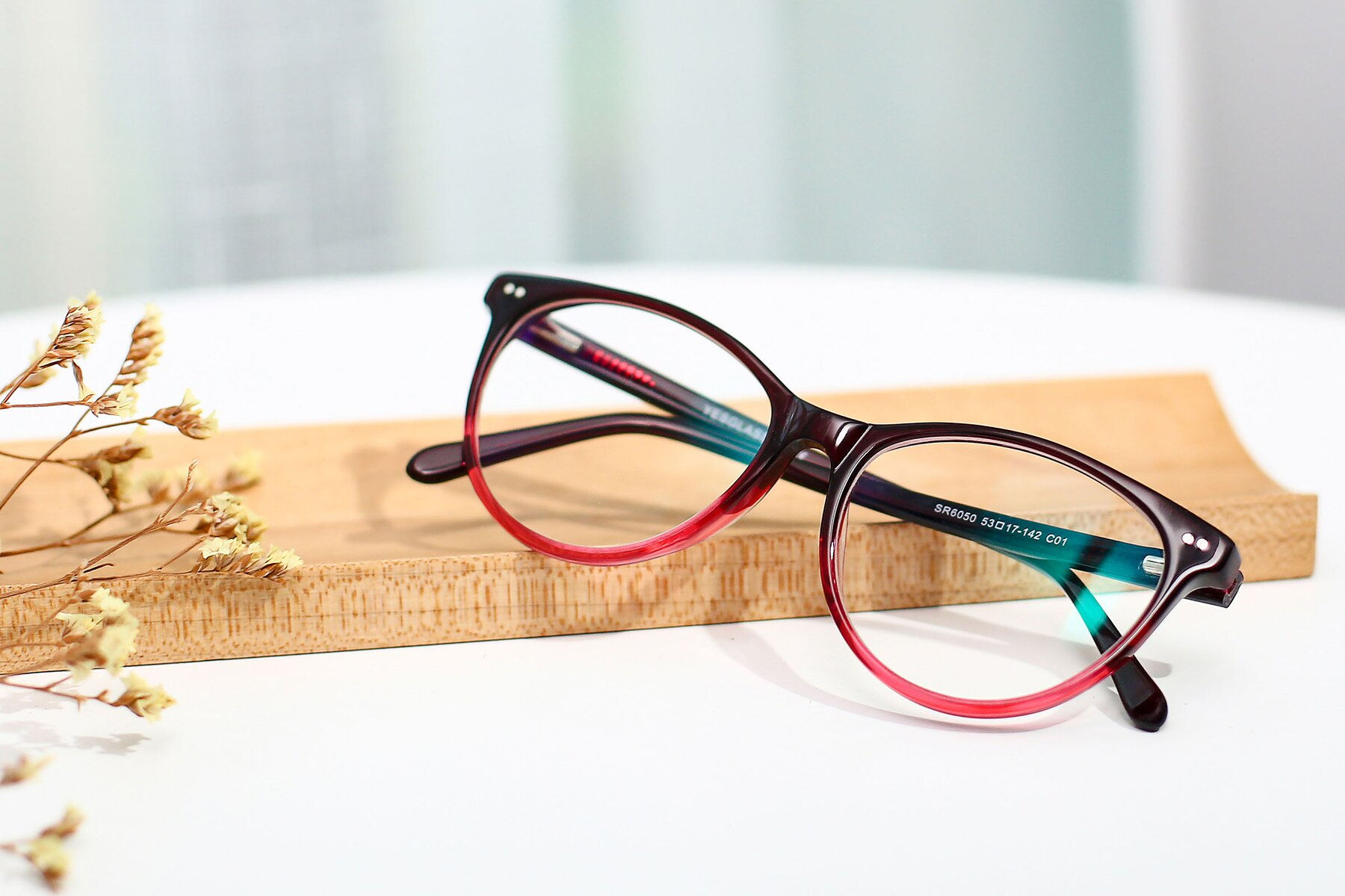 Women's lifestyle photography #1 of SR6050 in Transparent Gradient Wine with Clear Eyeglass Lenses