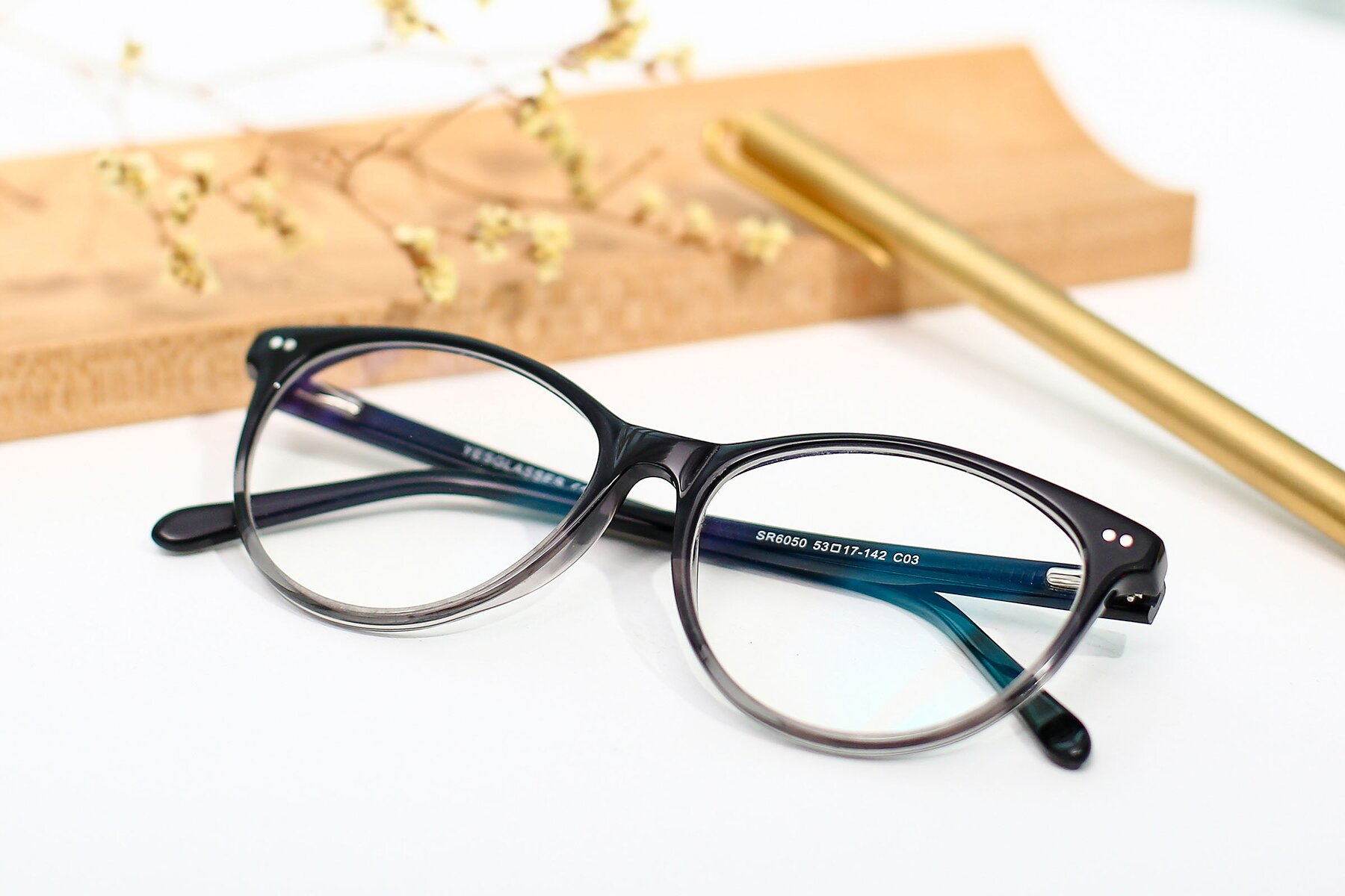 Women's lifestyle photography #1 of SR6050 in Transparent Gradient Black with Clear Eyeglass Lenses