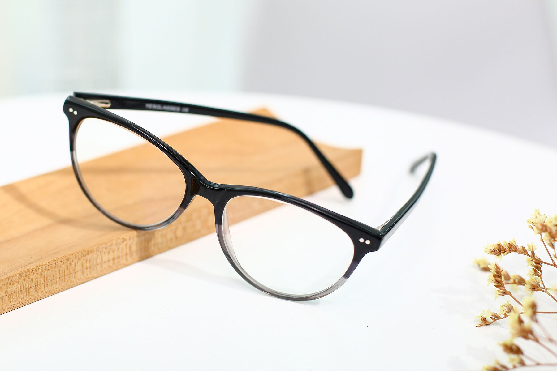Women's lifestyle photography #2 of SR6050 in Transparent Gradient Black with Clear Eyeglass Lenses