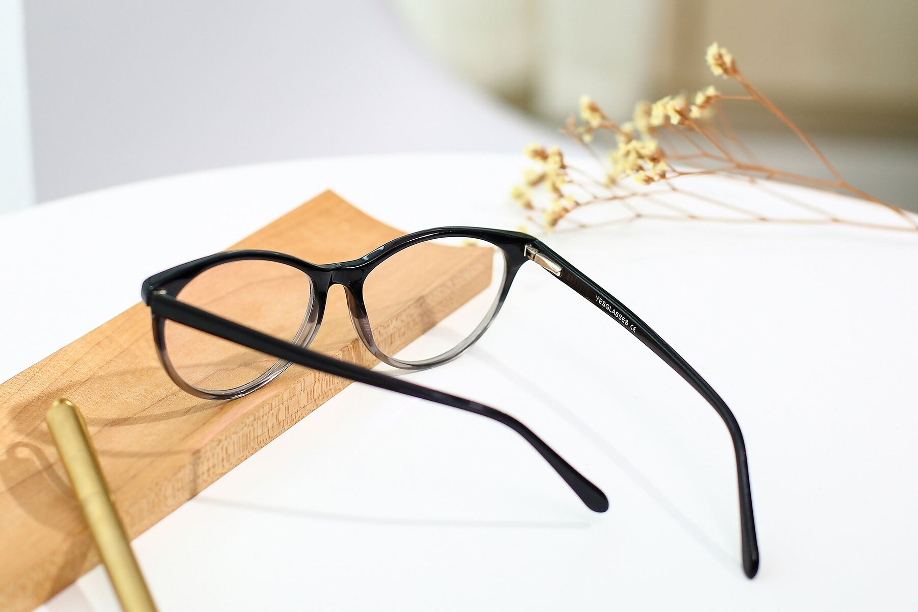 Women's lifestyle photography #3 of SR6050 in Transparent Gradient Black with Clear Eyeglass Lenses
