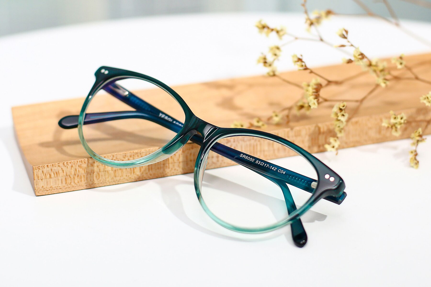 Women's lifestyle photography #1 of SR6050 in Transparent Gradient Green with Clear Eyeglass Lenses