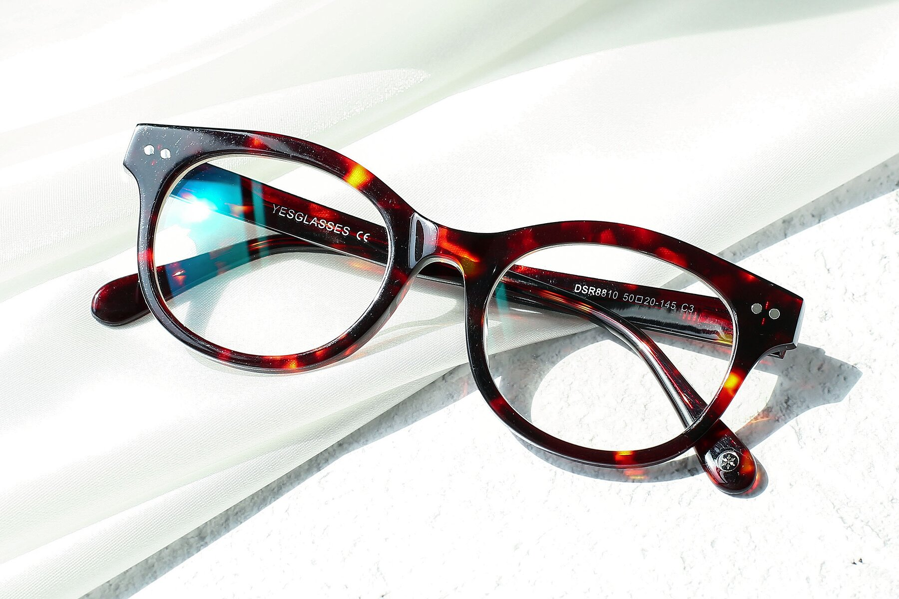Women's lifestyle photography #1 of DSR8810 in Wine Tortoise with Clear Eyeglass Lenses