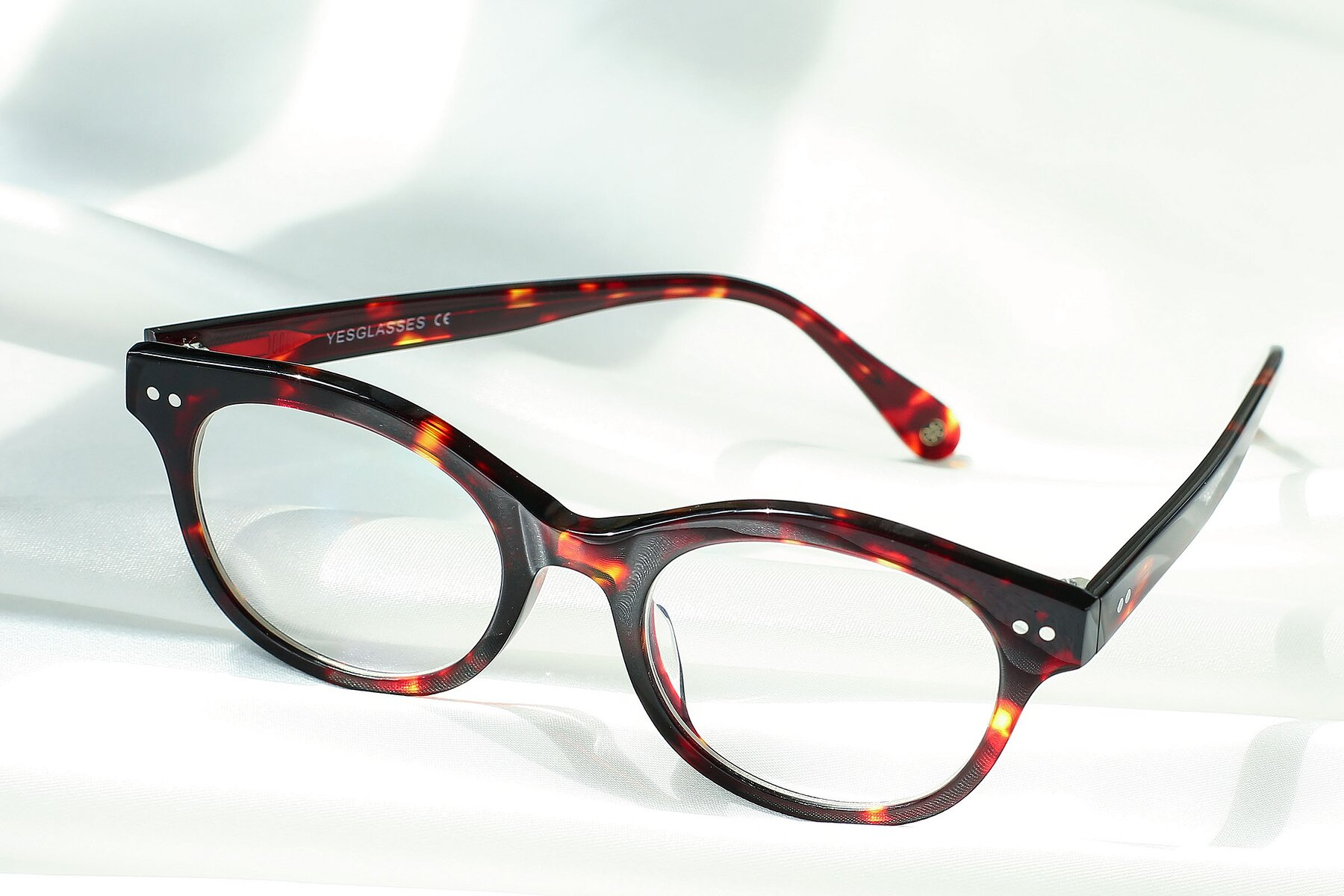 Women's lifestyle photography #2 of DSR8810 in Wine Tortoise with Clear Eyeglass Lenses