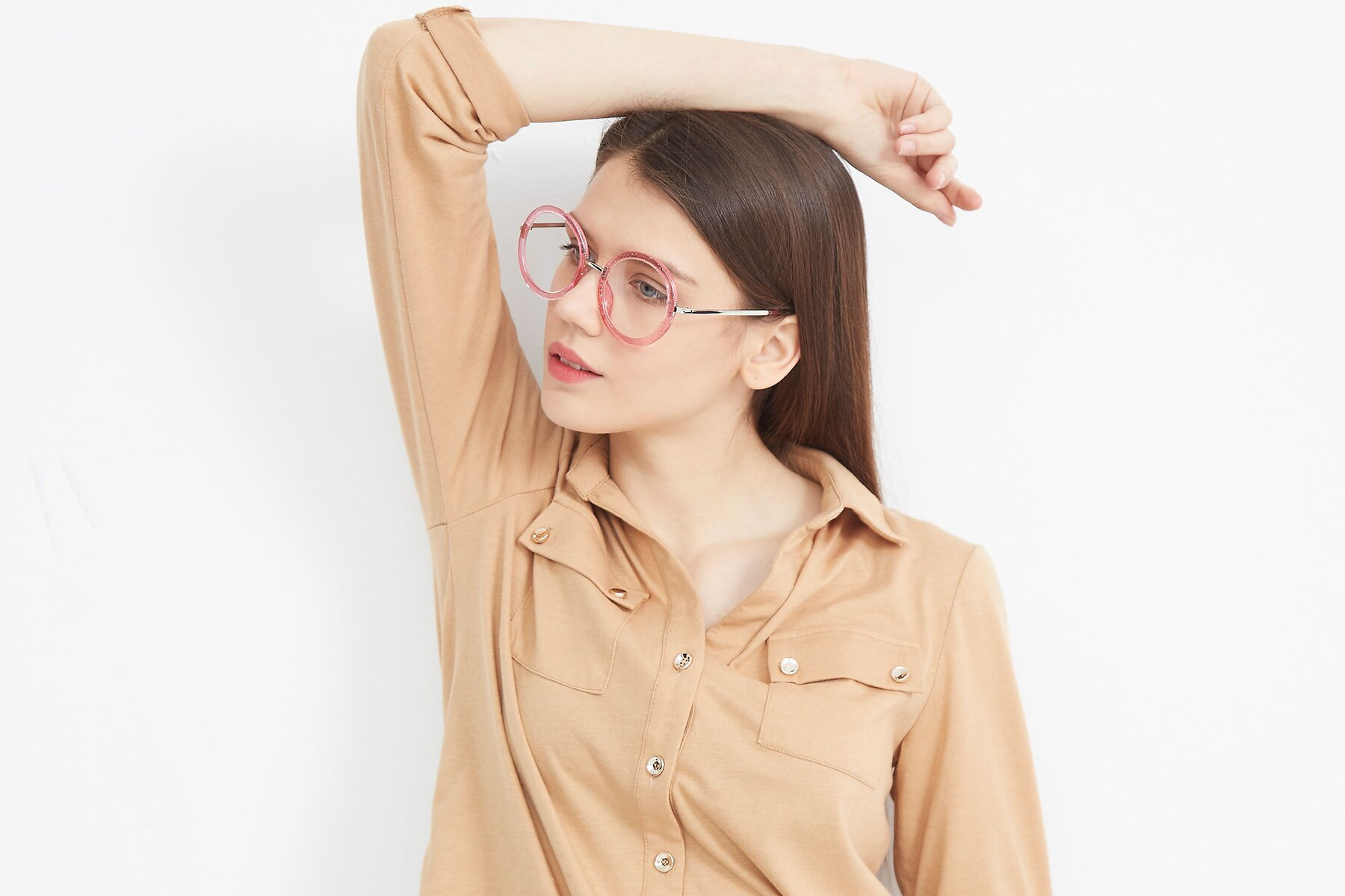 Women's lifestyle photography (landscape-2) of Bloom in Transparent Pearl Pink with Clear Eyeglass Lenses