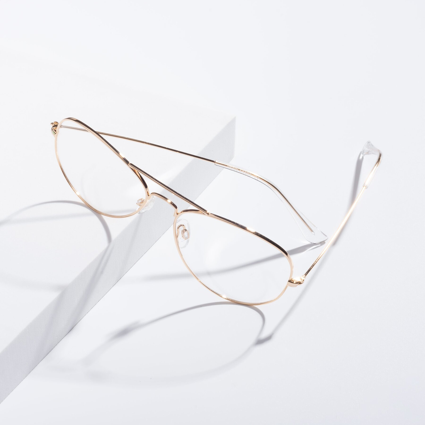 Lifestyle photography #2 of Yesterday in Shiny Gold with Clear Eyeglass Lenses