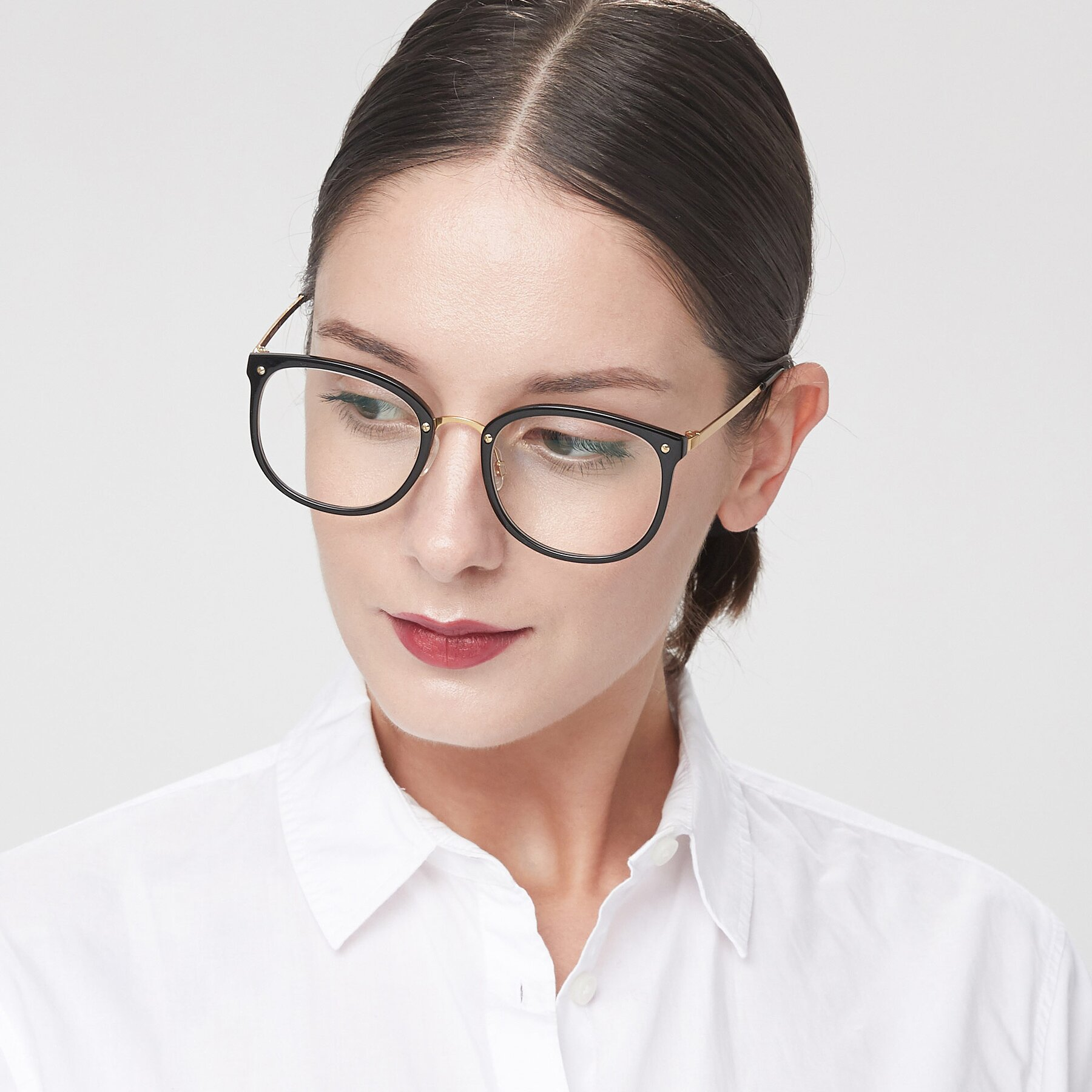 Women's lifestyle photography of Timeless in Black-Gold with Clear Eyeglass Lenses