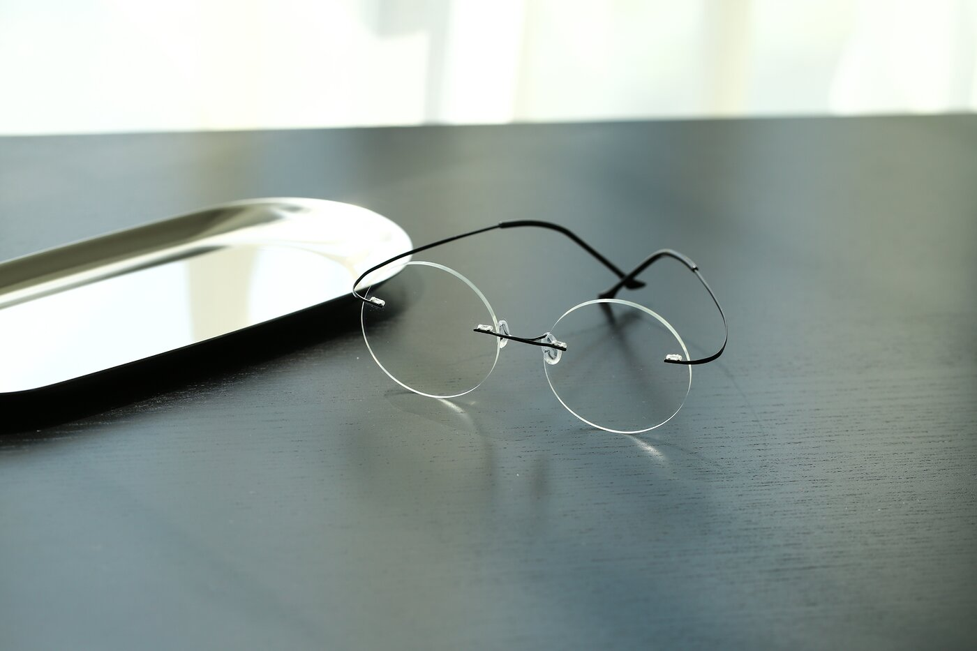 Black Lightweight Round Rimless Eyeglasses