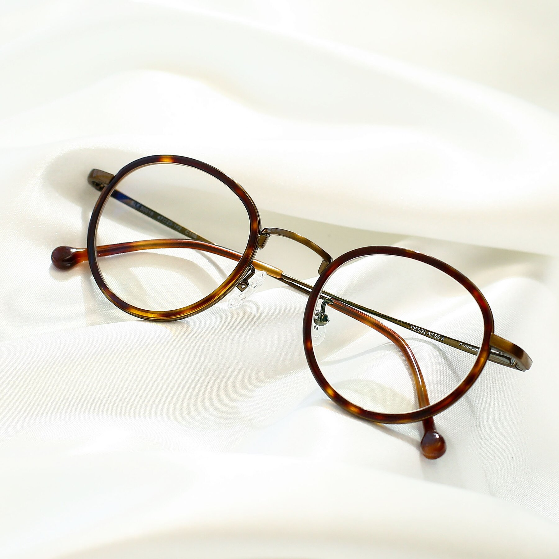 Lifestyle photography #1 of Troy in Bronze-Tortoise with Clear Eyeglass Lenses