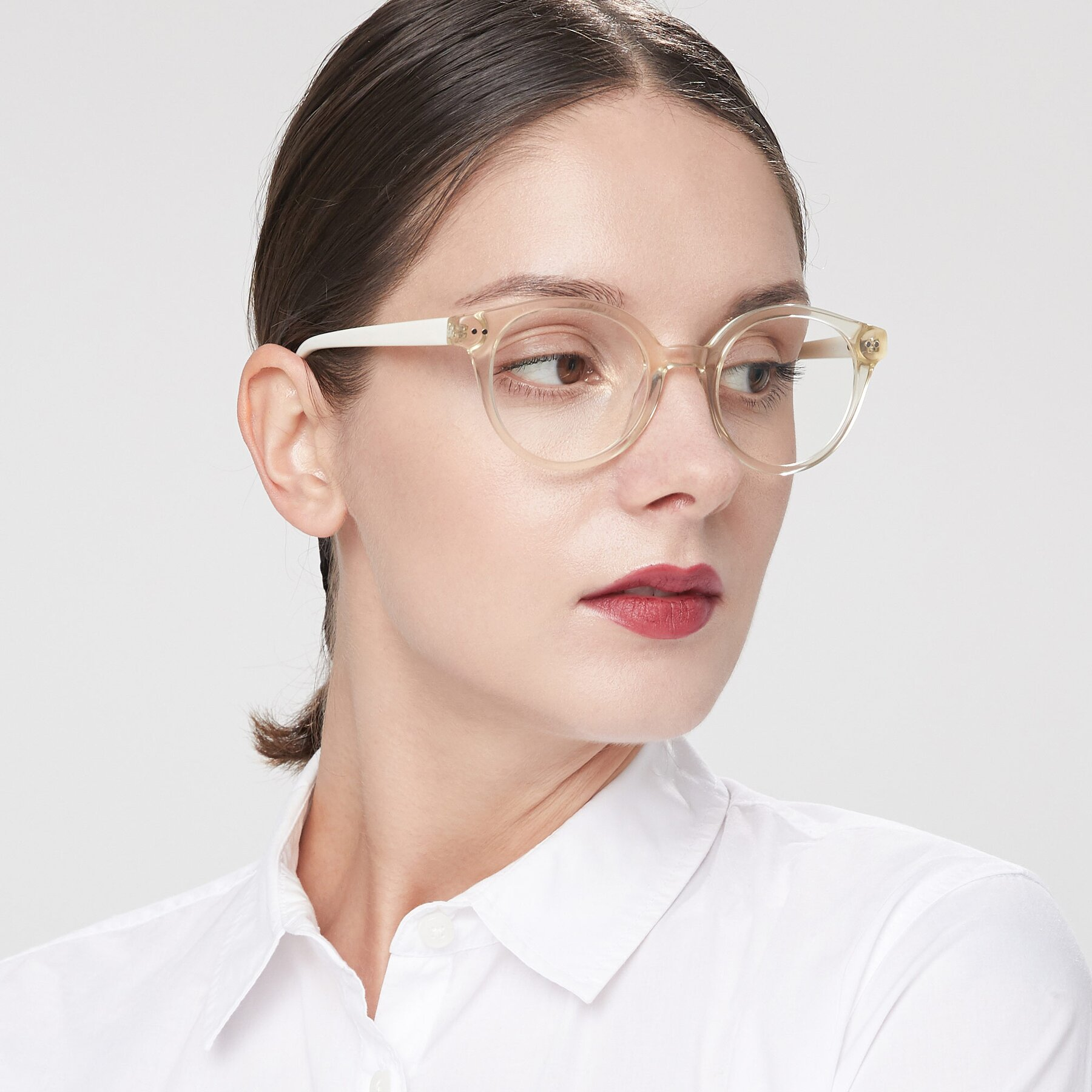 Women's lifestyle photography of 17277 in Transparent Beige with Clear Blue Light Blocking Lenses