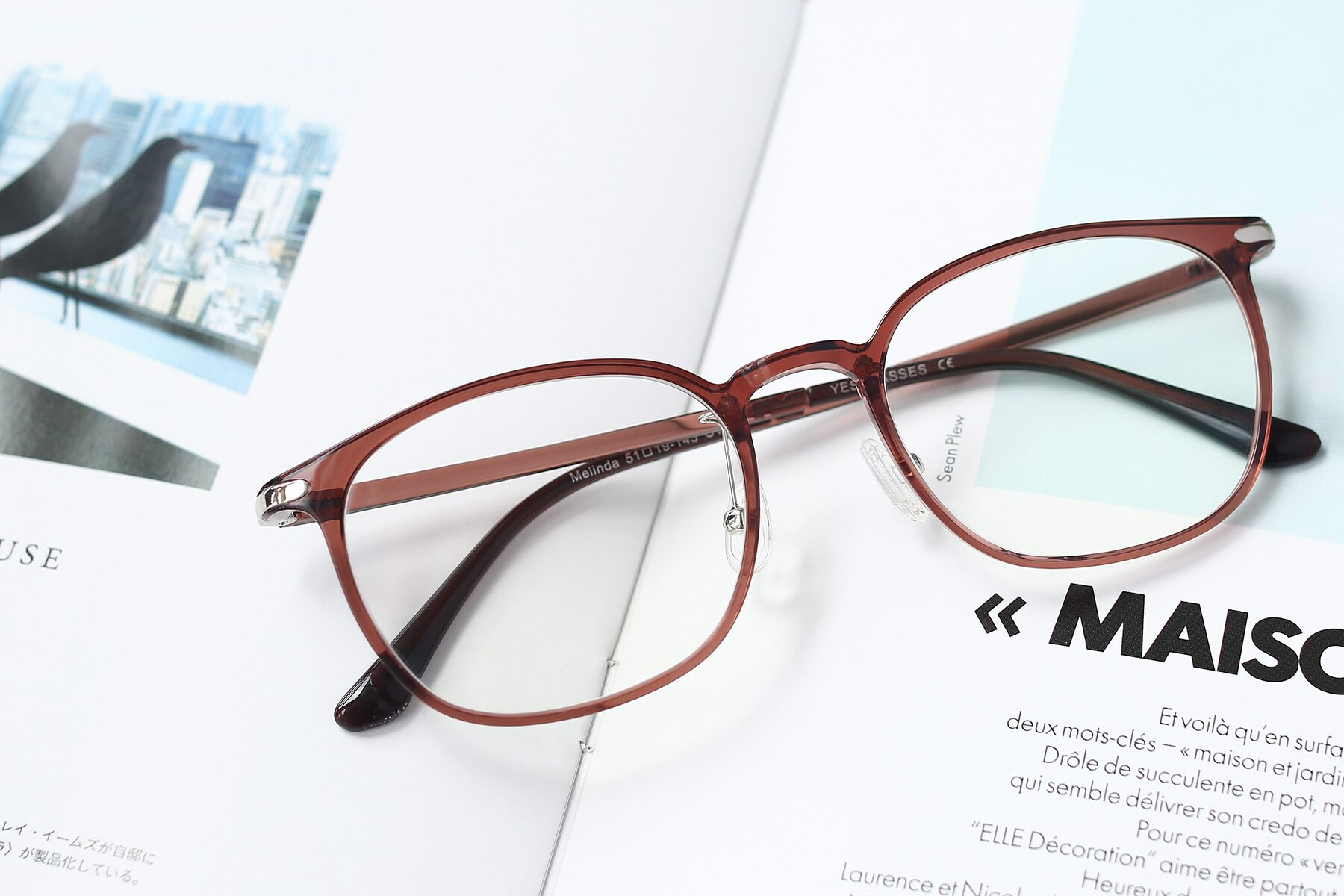 Lifestyle photography #1 of Melinda in Brown with Clear Eyeglass Lenses