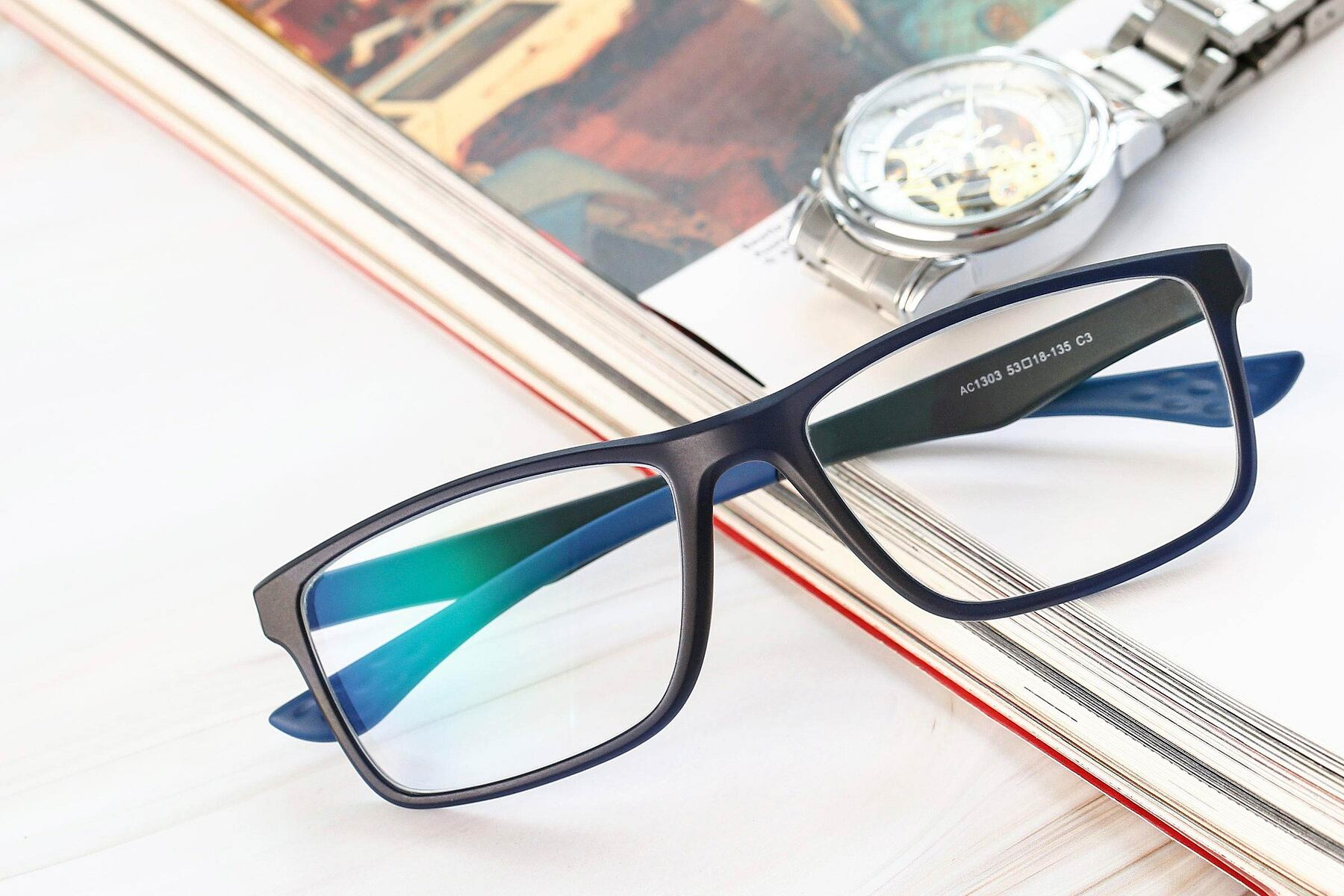 Men's lifestyle photography #1 of AC1303 in Matte Blue with Clear Eyeglass Lenses