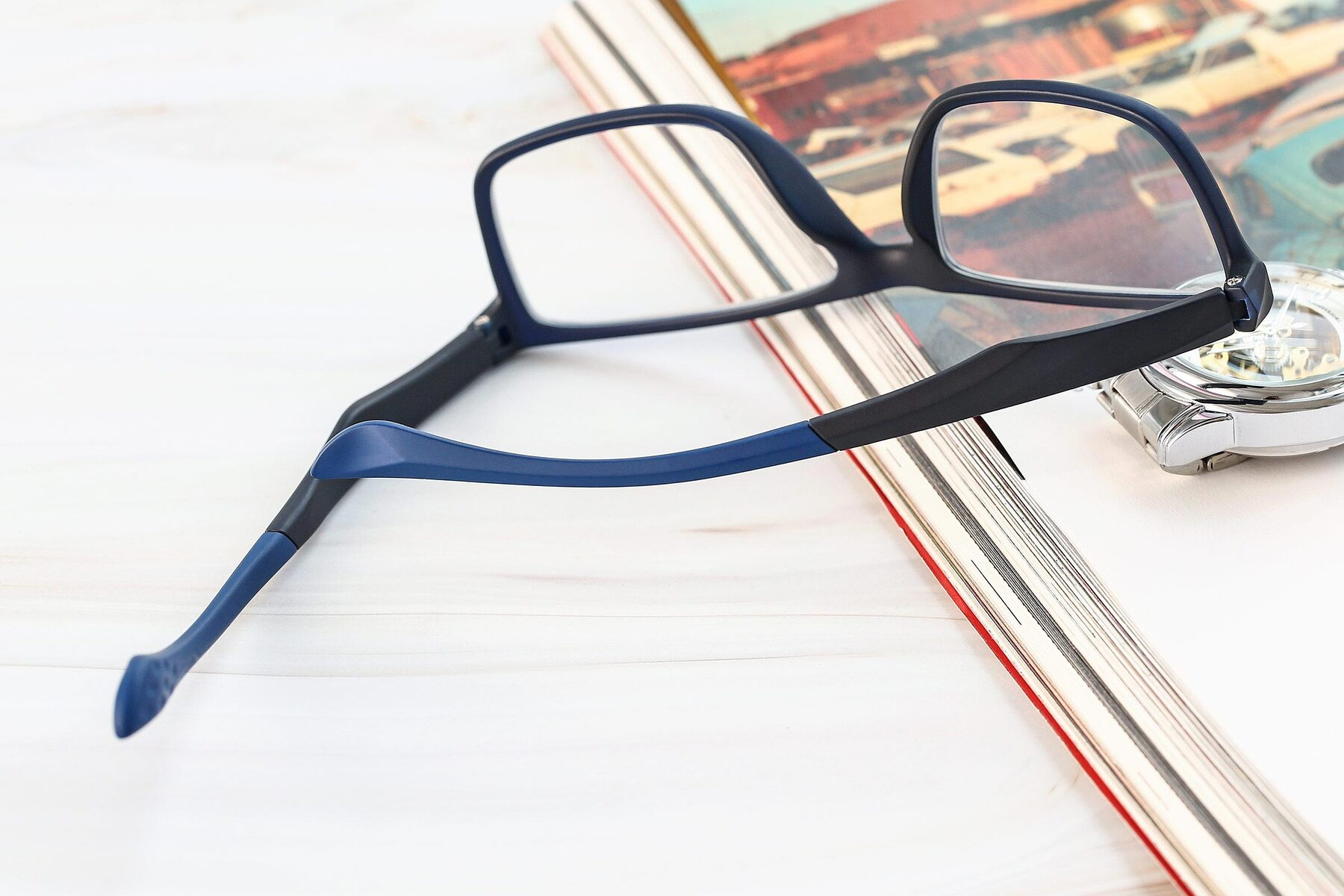 Men's lifestyle photography #2 of AC1303 in Matte Blue with Clear Eyeglass Lenses