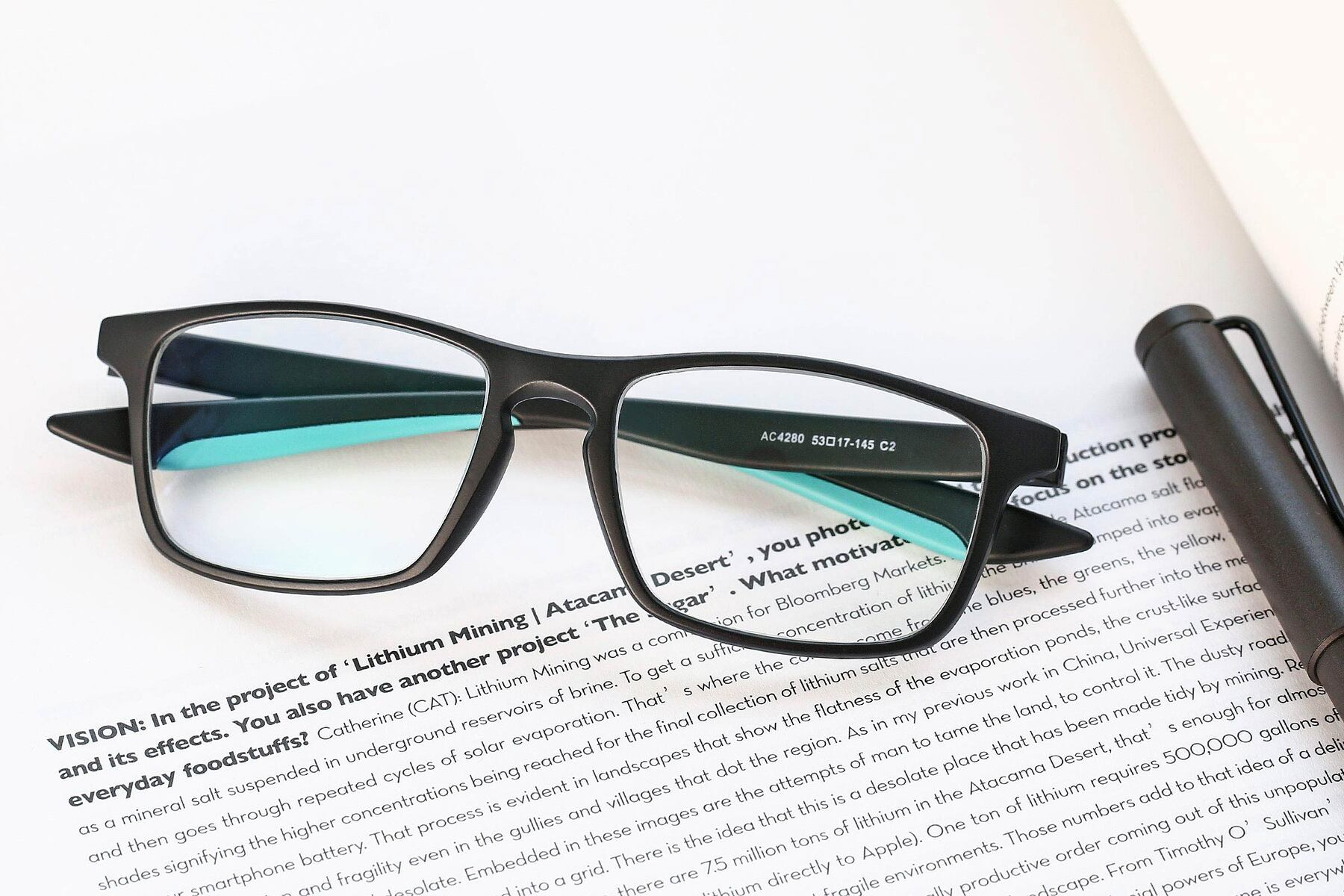 Lifestyle photography #1 of AC4280 in Matte Black-Cyan with Clear Eyeglass Lenses
