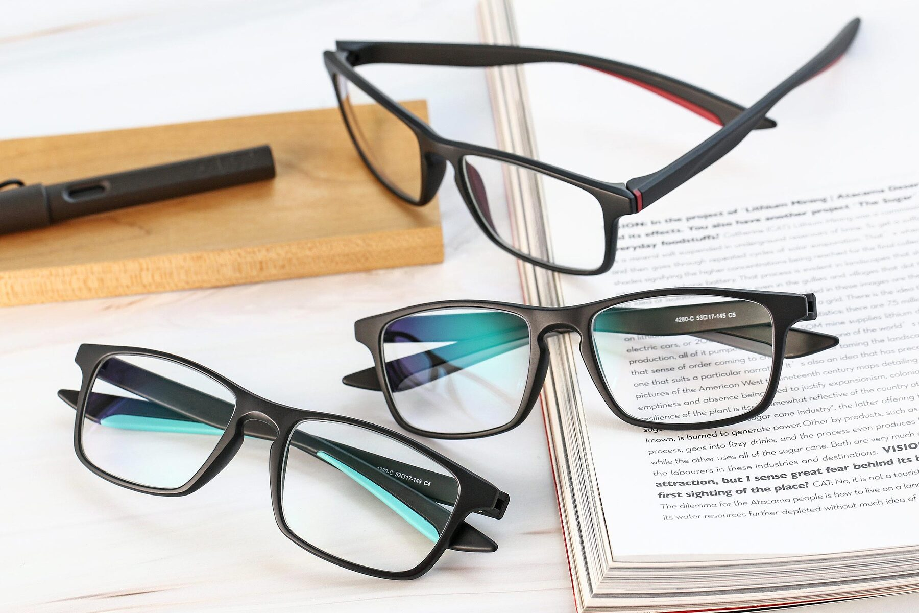 Lifestyle photography #4 of AC4280 in Matte Black-Cyan with Clear Eyeglass Lenses