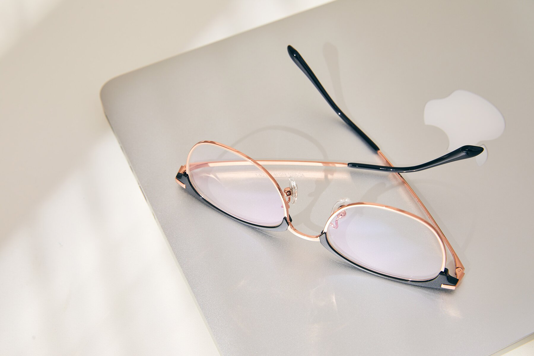 Lifestyle photography #2 of XC-5002 in Black-Rose Gold with Clear Eyeglass Lenses