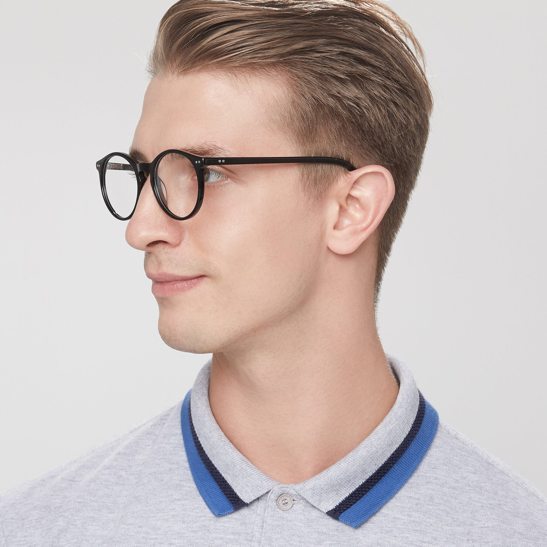 Men's lifestyle photography of Echo in Black with Clear Blue Light Blocking Lenses