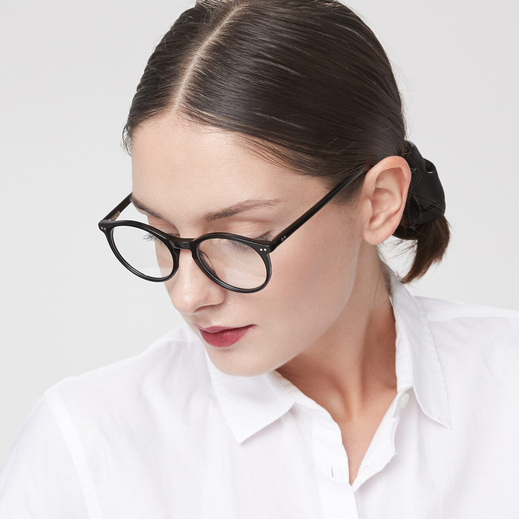 Women's lifestyle photography of Echo in Black with Clear Blue Light Blocking Lenses