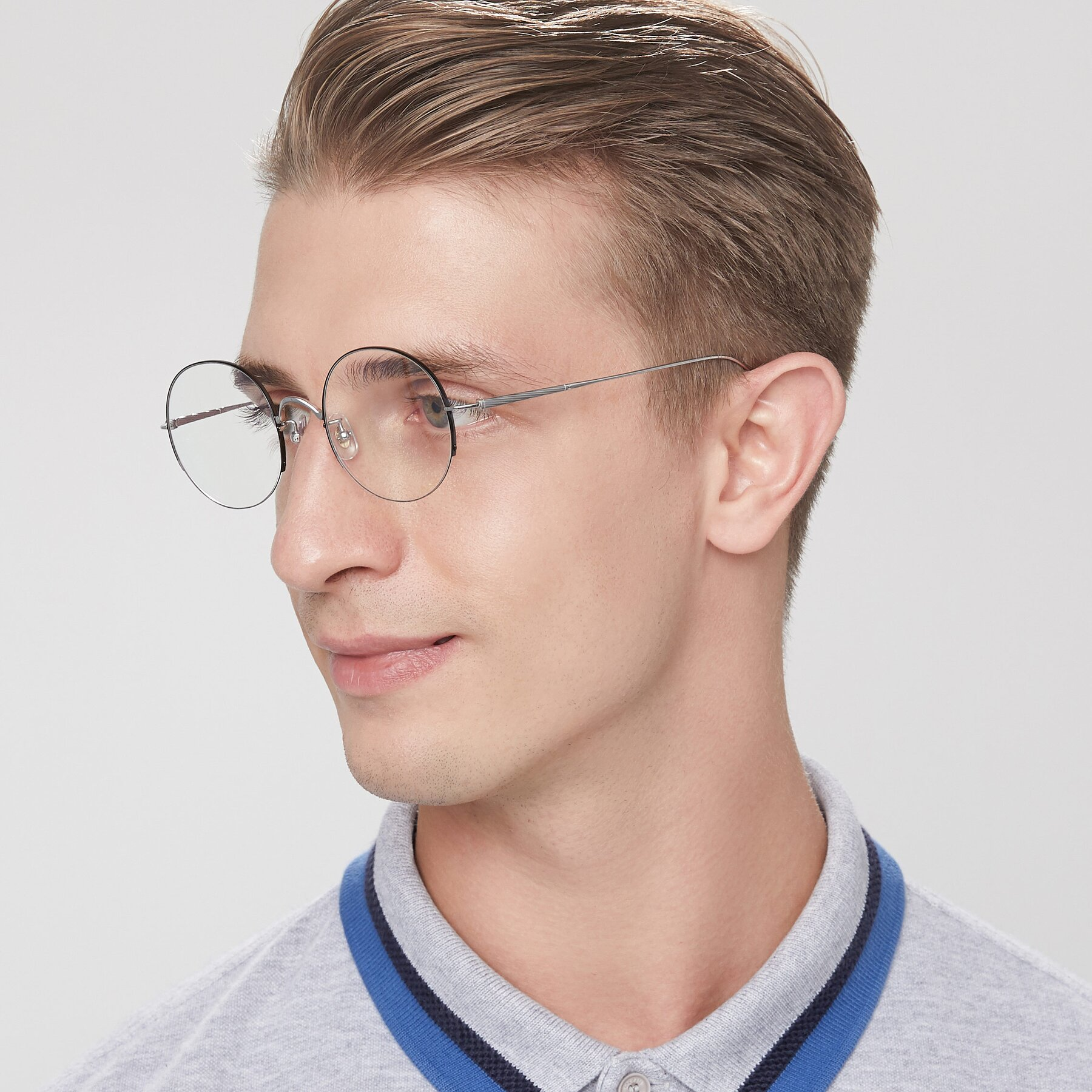 Men's lifestyle photography of Harry in Peafowl Green with Clear Eyeglass Lenses