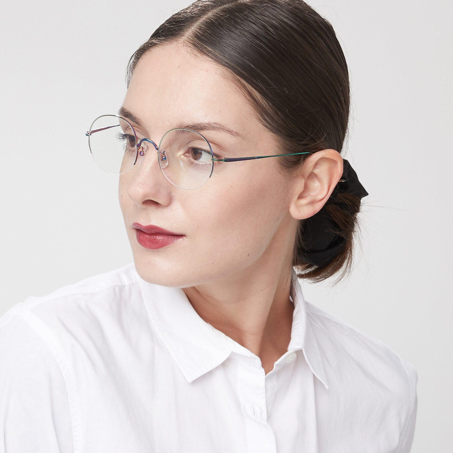 Women's lifestyle photography of Harry in Peafowl Green with Clear Eyeglass Lenses