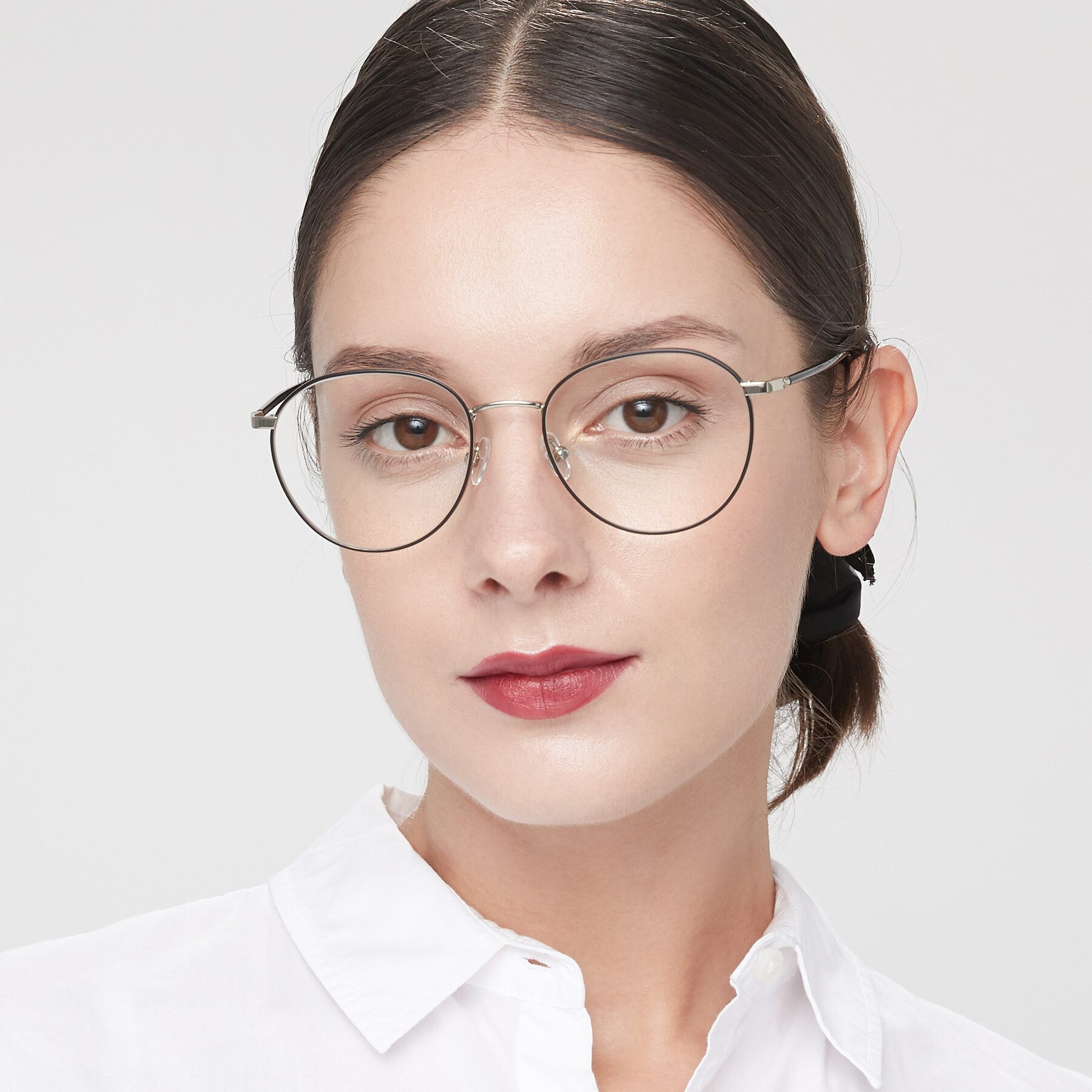 Women's lifestyle photography of 9553 in Black-Silver with Clear Eyeglass Lenses