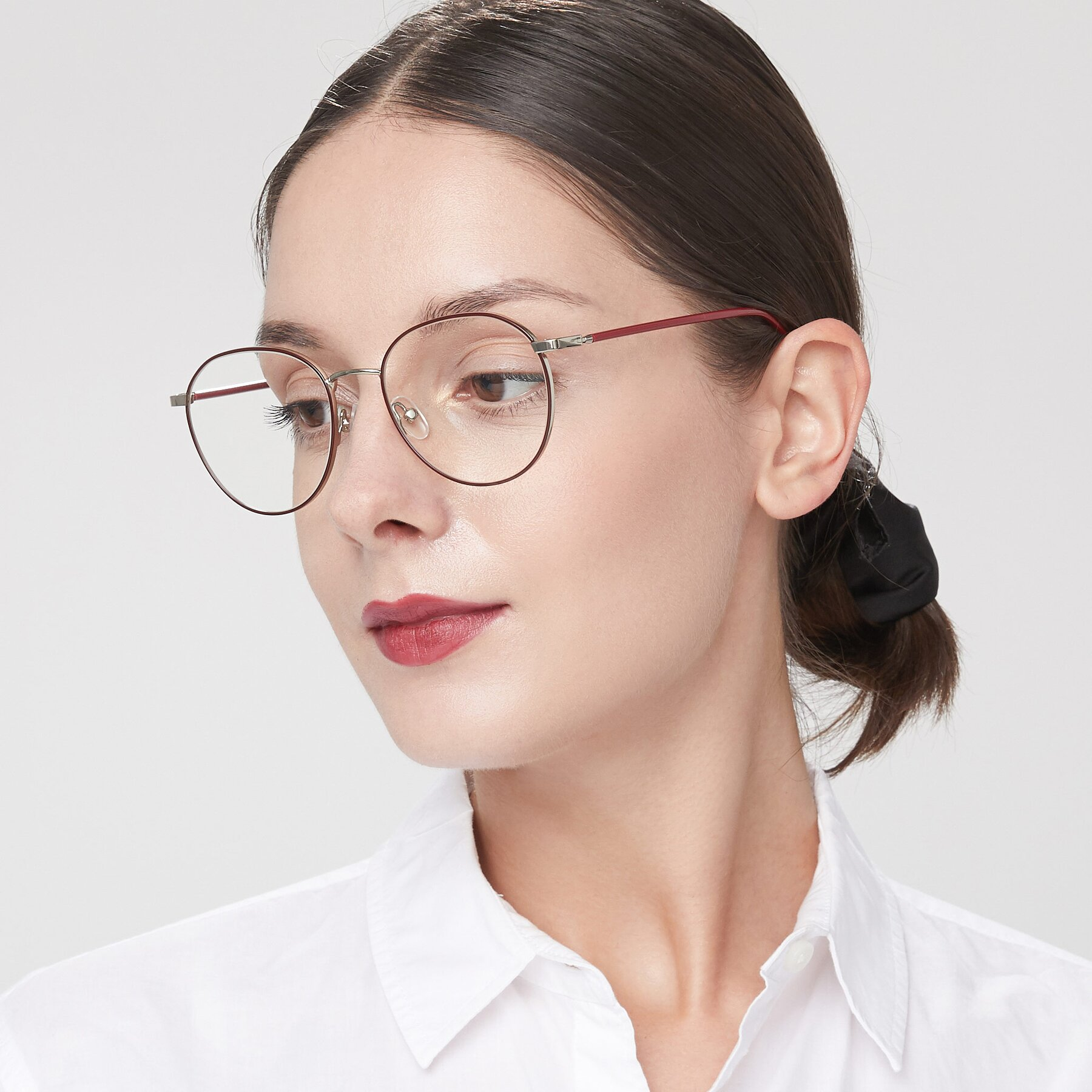 Women's lifestyle photography of 9553 in Wine-Silver with Clear Blue Light Blocking Lenses