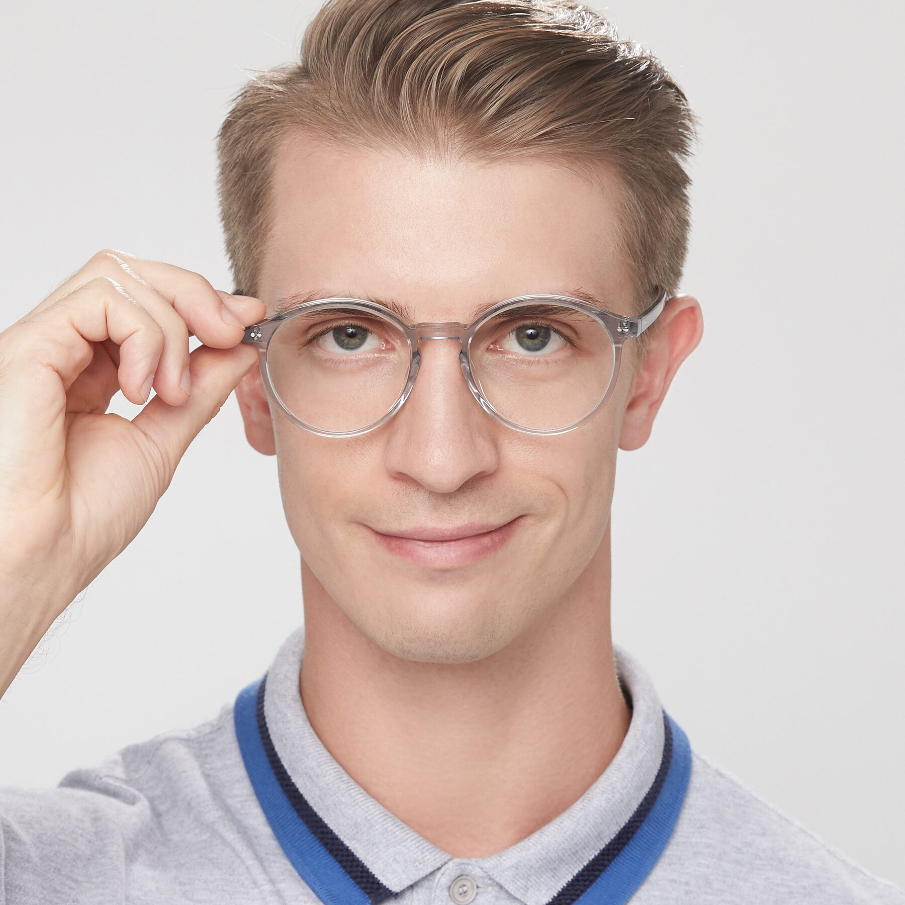 Men's lifestyle photography of 17571 in Transparent Grey with Clear Blue Light Blocking Lenses