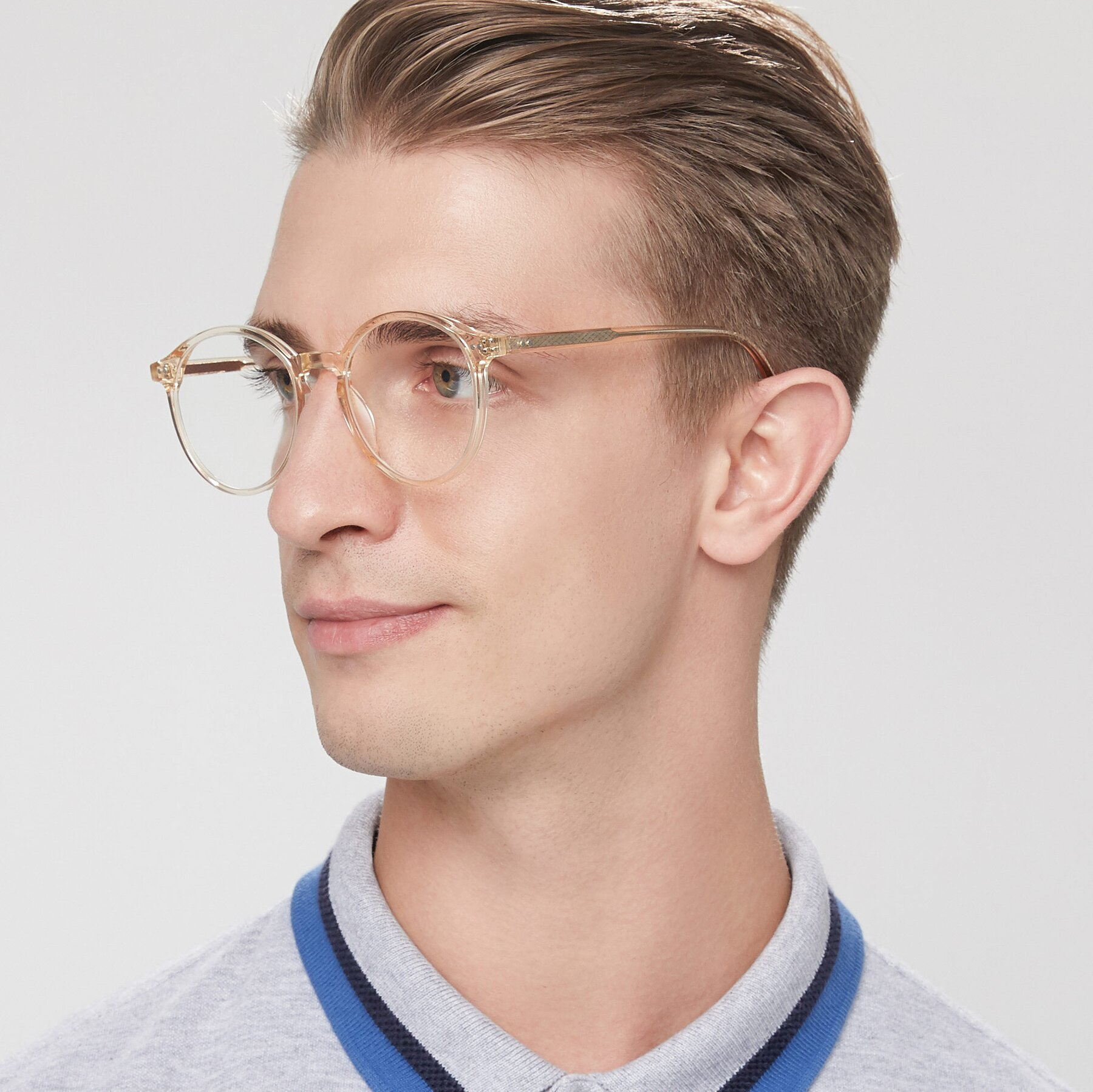 Men's lifestyle photography of 17571 in Transparent Caramel with Clear Blue Light Blocking Lenses