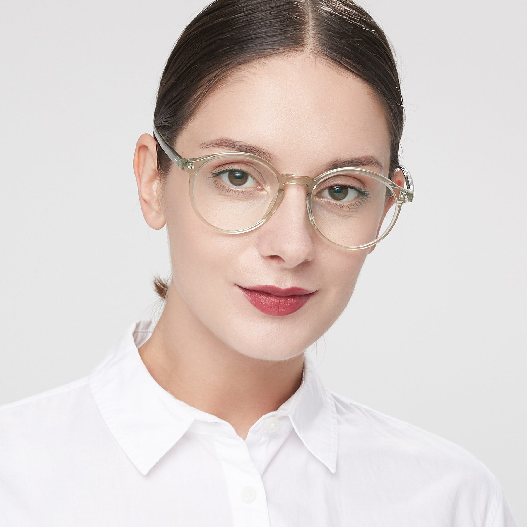 Women's lifestyle photography of 17571 in Transparent Green with Clear Eyeglass Lenses