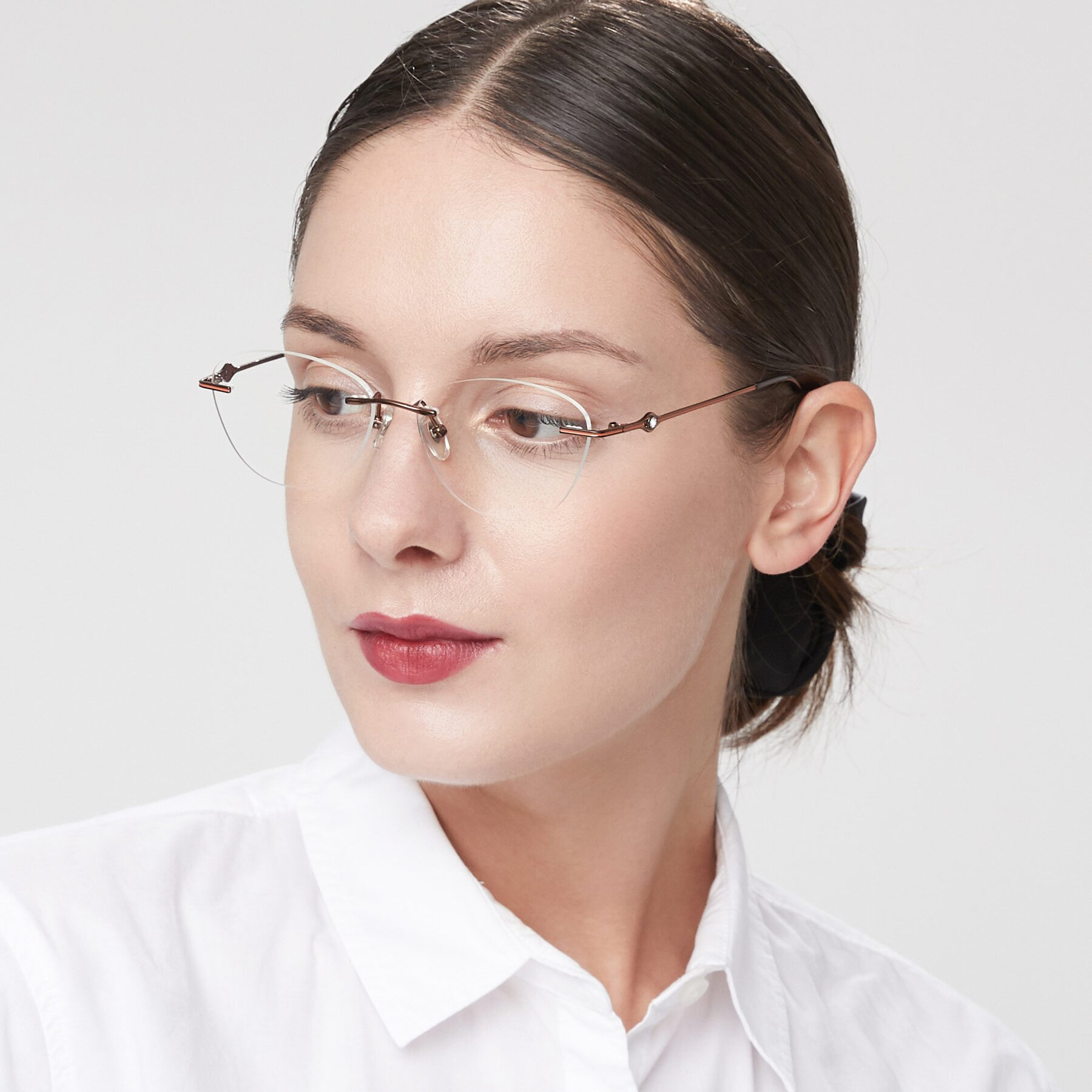 Women's lifestyle photography of 19005 in Bronze with Clear Blue Light Blocking Lenses