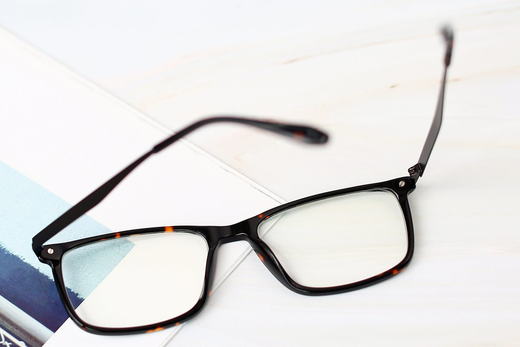Lifestyle photography #2 of T002 in Tortoise with Clear Eyeglass Lenses