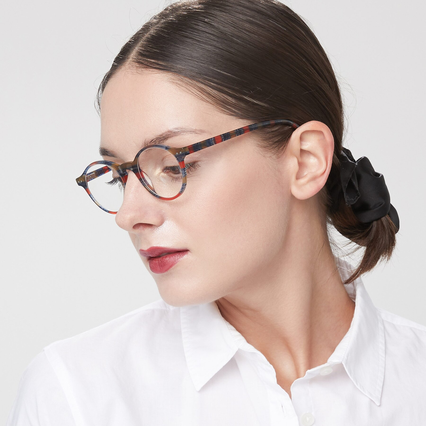 Women's lifestyle photography of 17519 in Stripe Blue Red with Clear Eyeglass Lenses