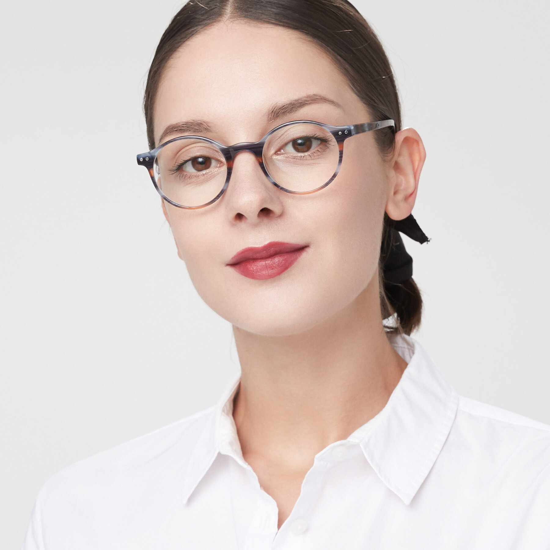 Women's lifestyle photography of 17519 in Stripe Blue Brown with Clear Eyeglass Lenses