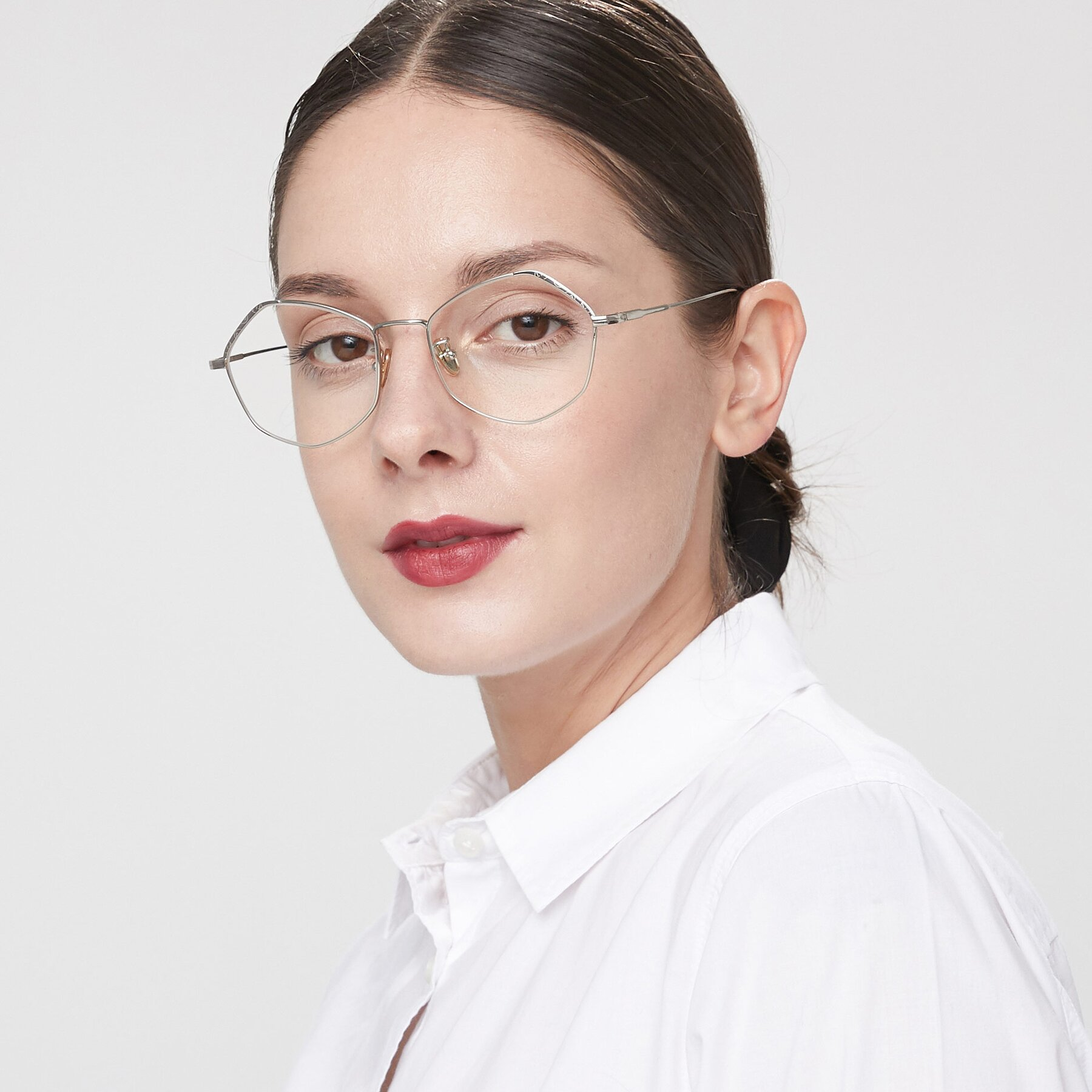 Women's lifestyle photography of Phoenix in Silver with Clear Eyeglass Lenses